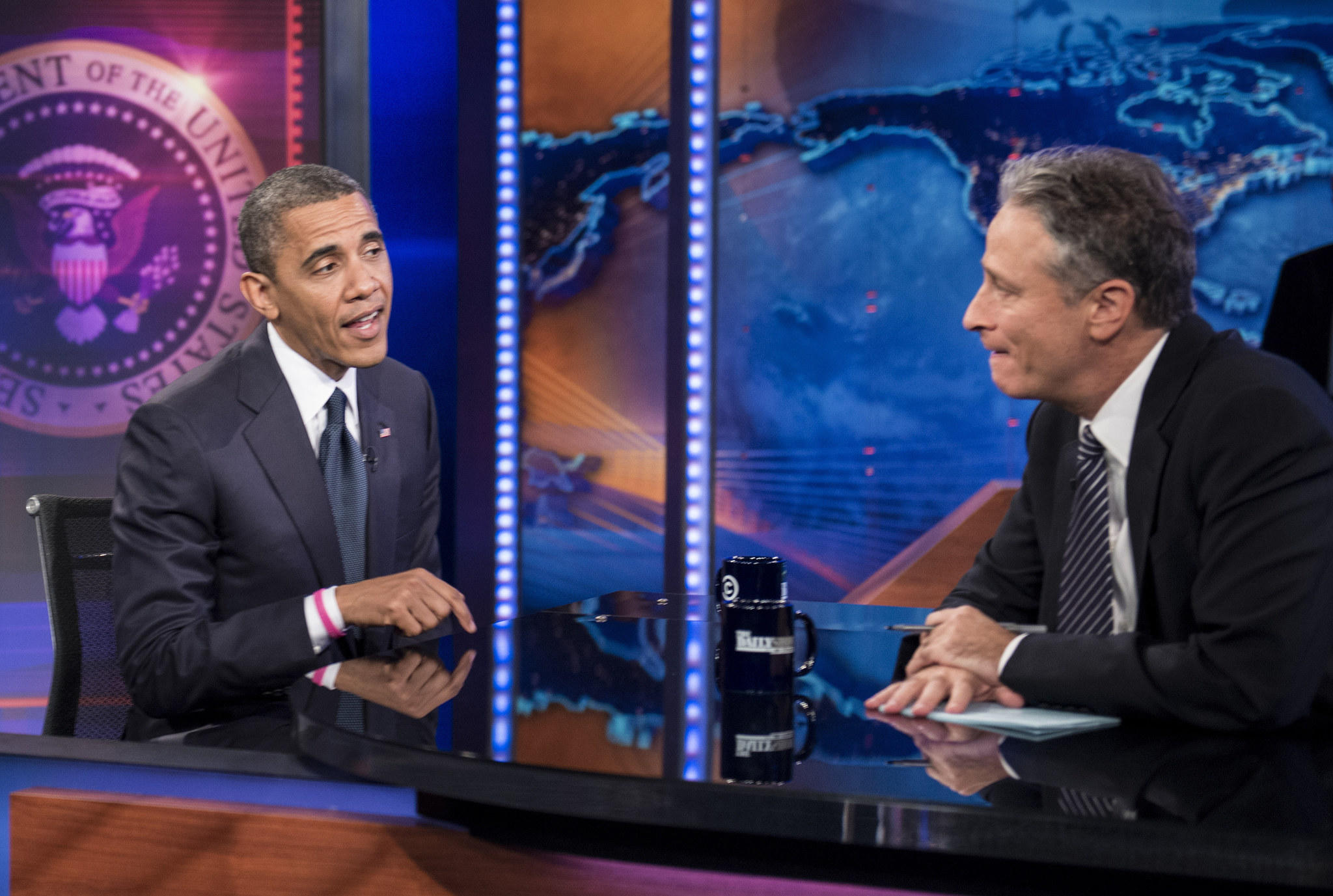 """President Barack Obama and host Jon Stewart speak during a break in the live taping of Comedy Central's """"Daily Show with Jon Stewart"""" on October 18, 2012 in New York."""