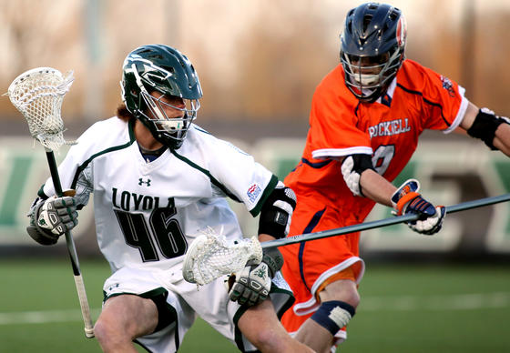 Bucknell midfielder Sam McDonough  plays some solid defense on Loyola University attacker Brian Schultz.