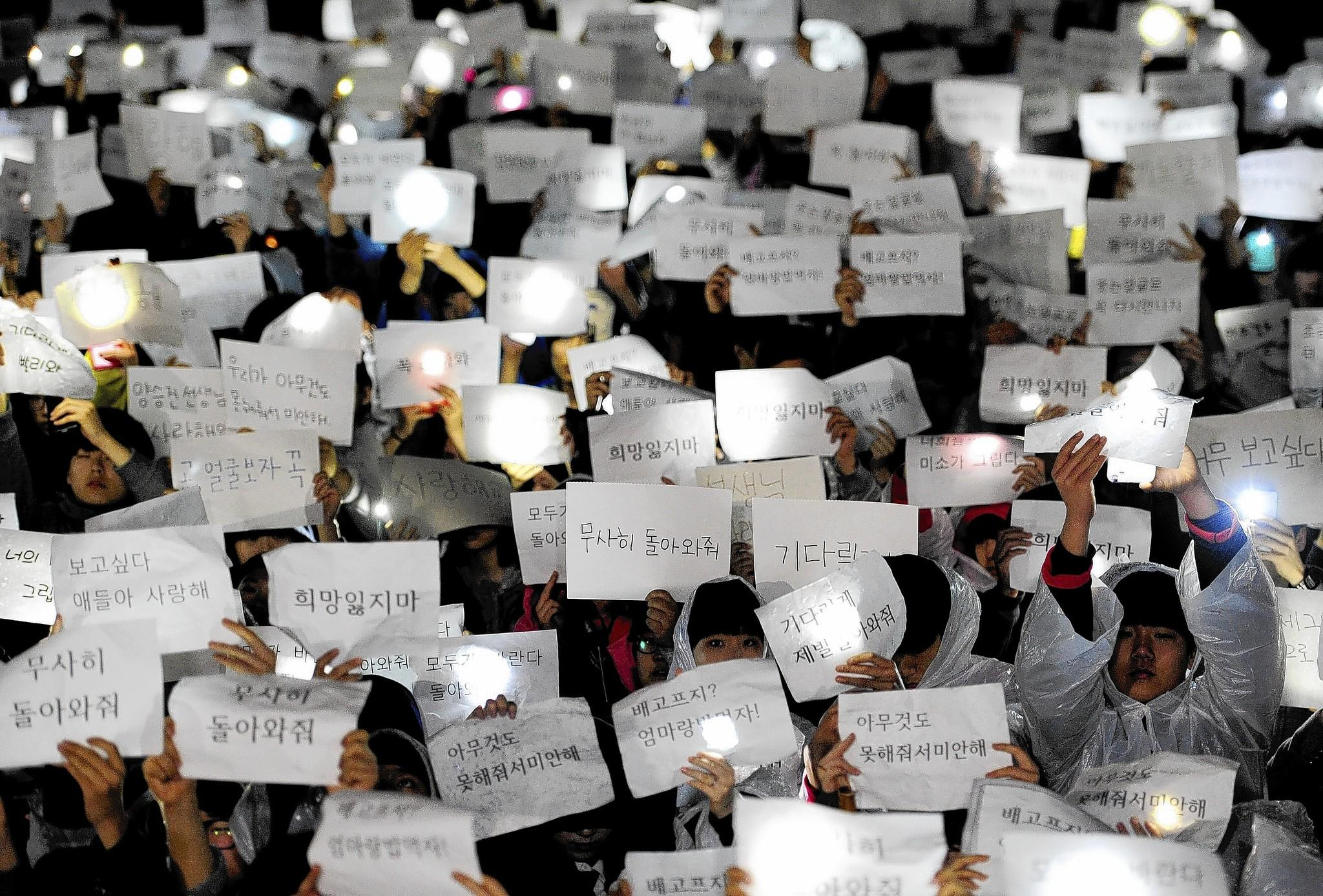 Students at Danwon High School in Ansan, South Korea, hold up messages for schoolmates missing in the ferry disaster.