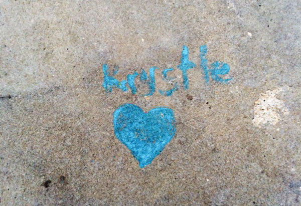 The site where Krystle Campbell died at the 2013 Boston Marathon is marked by a small heart and her name.
