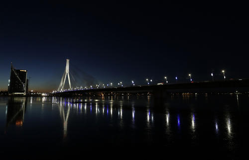 An illuminated suspension bridge over the Daugava river is pictured in Riga January 18, 2014.