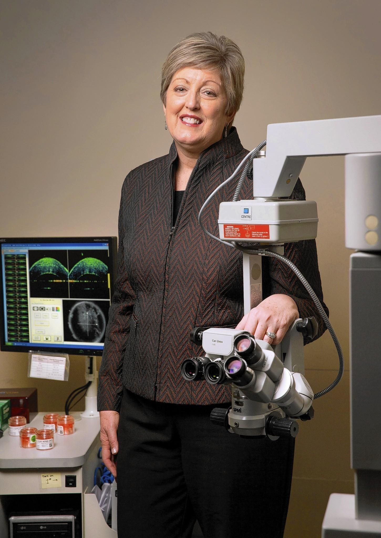 Diane Hollingsworth, executive director of the Illinois Eye-Bank, poses in the office lab, Monday, March 10, 2014.