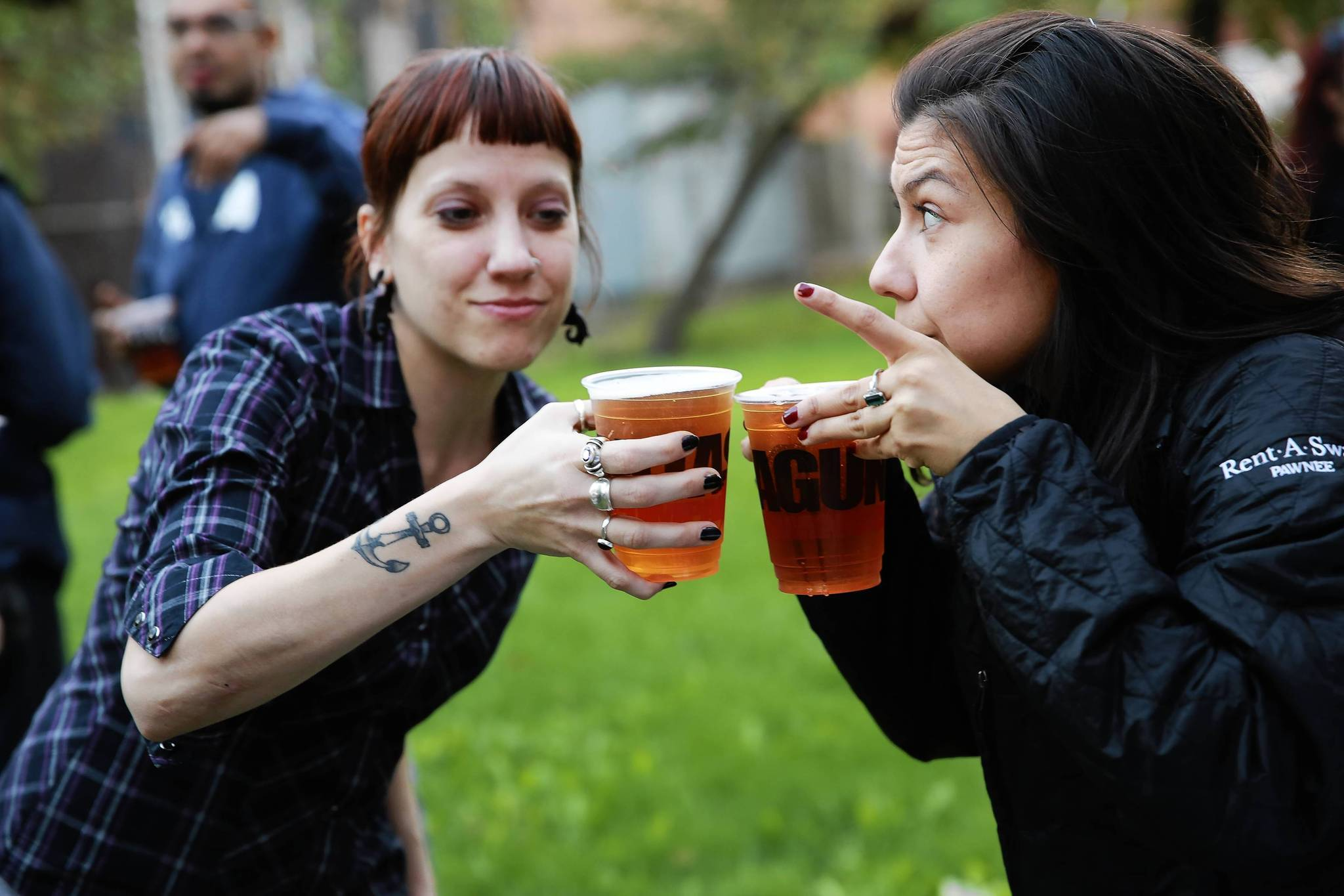 K.L. Kenzie, left, and Maegen Cadena toast each other with cups of Lagunitas IPA during a Happy Hour gathering at the Cinespace Chicago Film Studios in October.