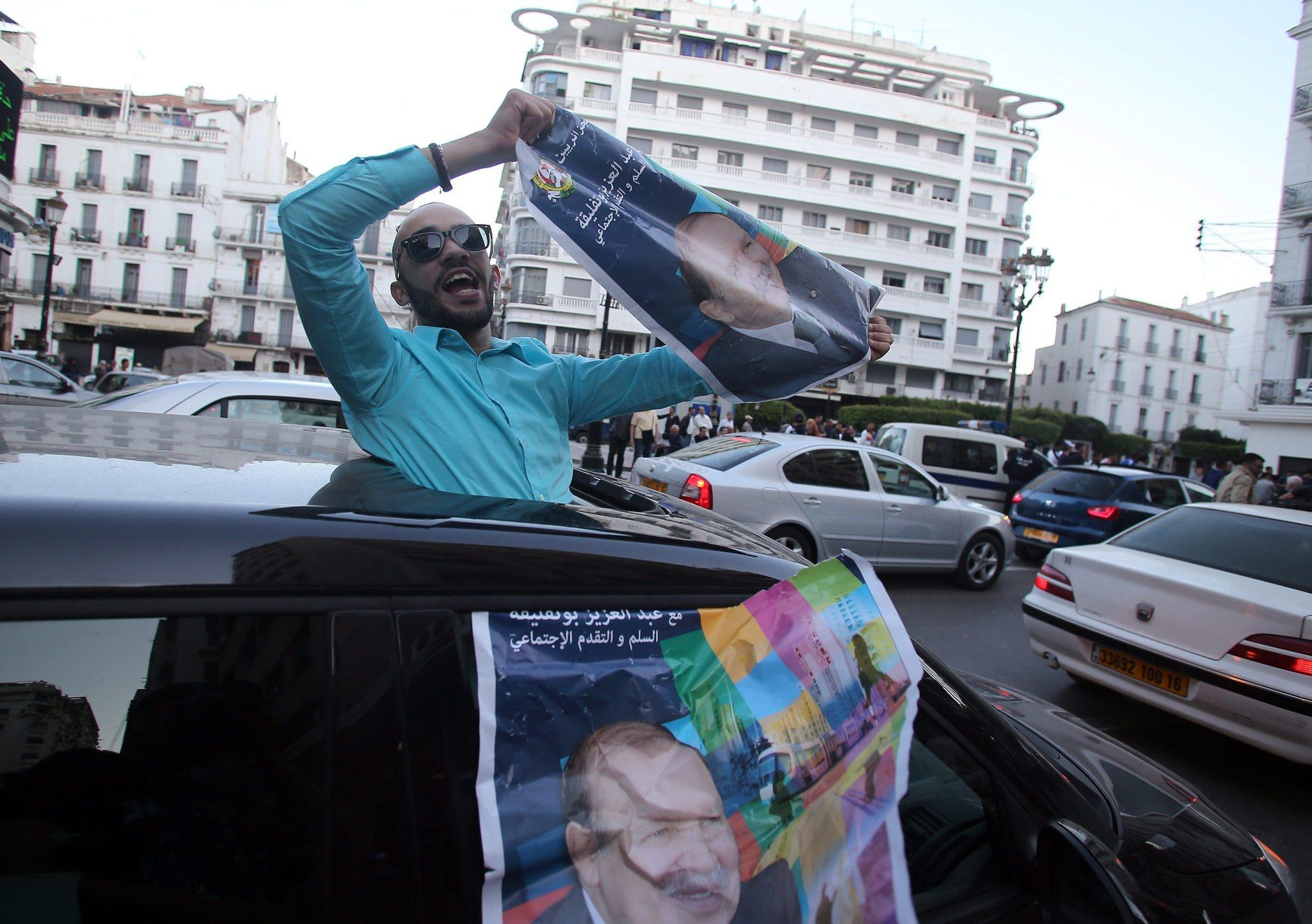 A supporter of Algerian President Abdelaziz Bouteflika celebrates his reelection.