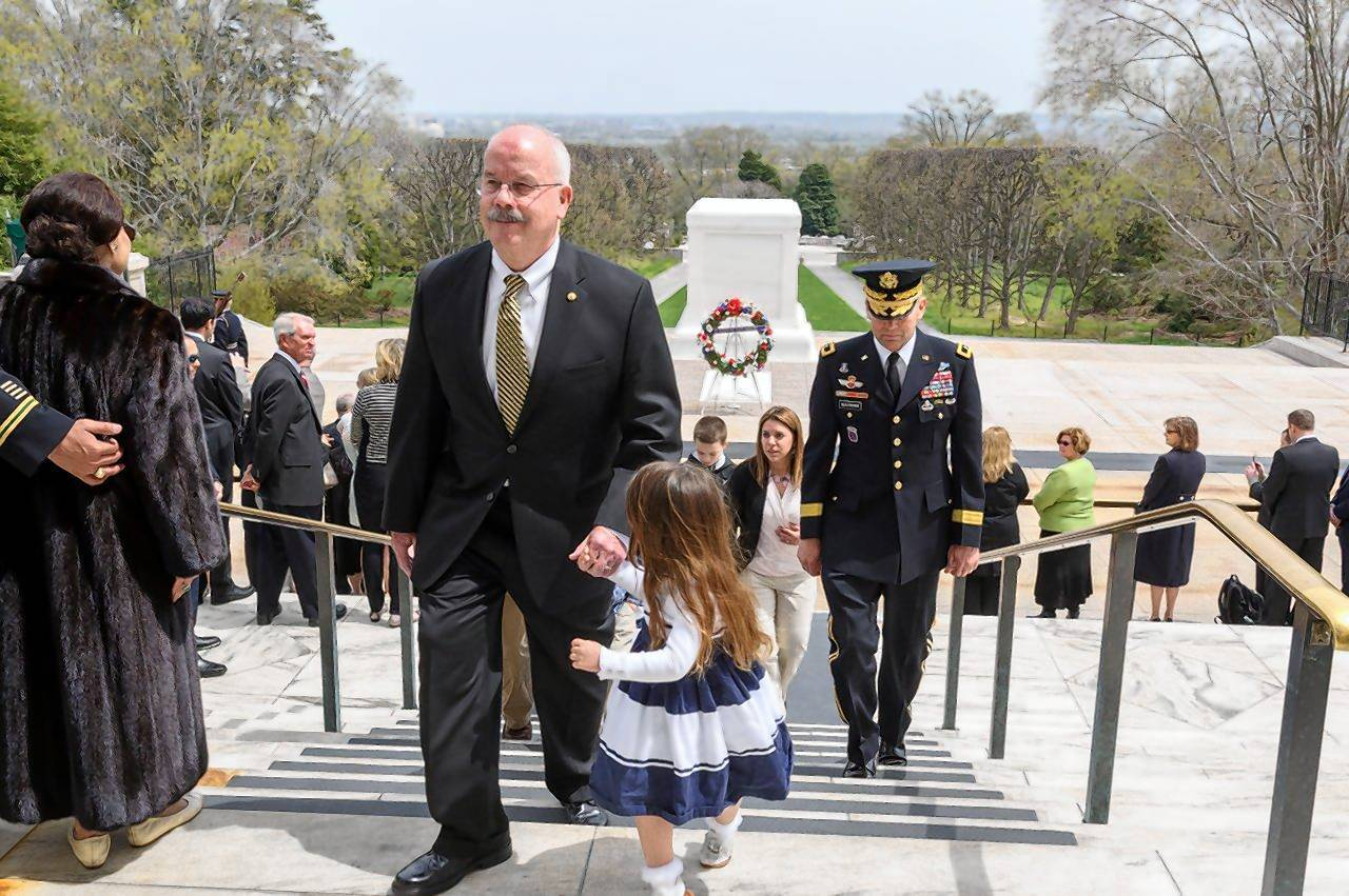 U.S. Senate Sergeant-at-Arms Terrance W. Gainer, a Chicago native, walks up the steps with his granddaughter Madeline Gainer, 4. Gainer is retiring May 2 after 46 years of public service, and laid a wreath at a ceremony Friday at the Tomb of the Unknown Soldier in Arlington National Cemetery.