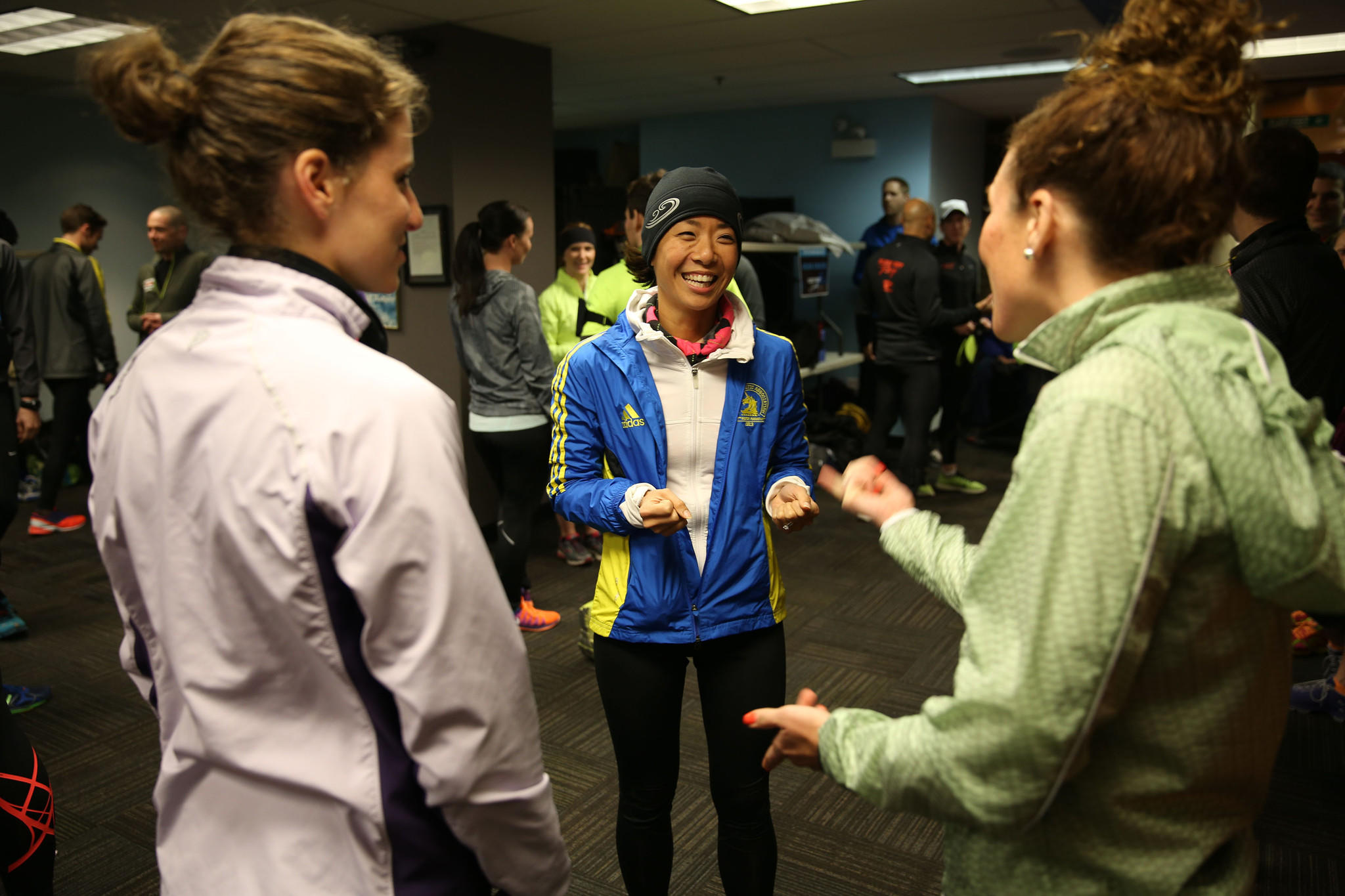 Jess Murphy, center, gathers with other runners at Fleet Feet Sports on North Wells Street in Chicago to train for the 2014 Boston Marathon despite having been in Boston during the 2013 marathon bombing there.