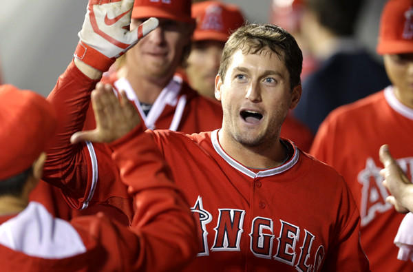 Angels third baseman David Freese is congratulated in the dugout after he hit a solo home run against the Seattle Mariners on Tuesday.