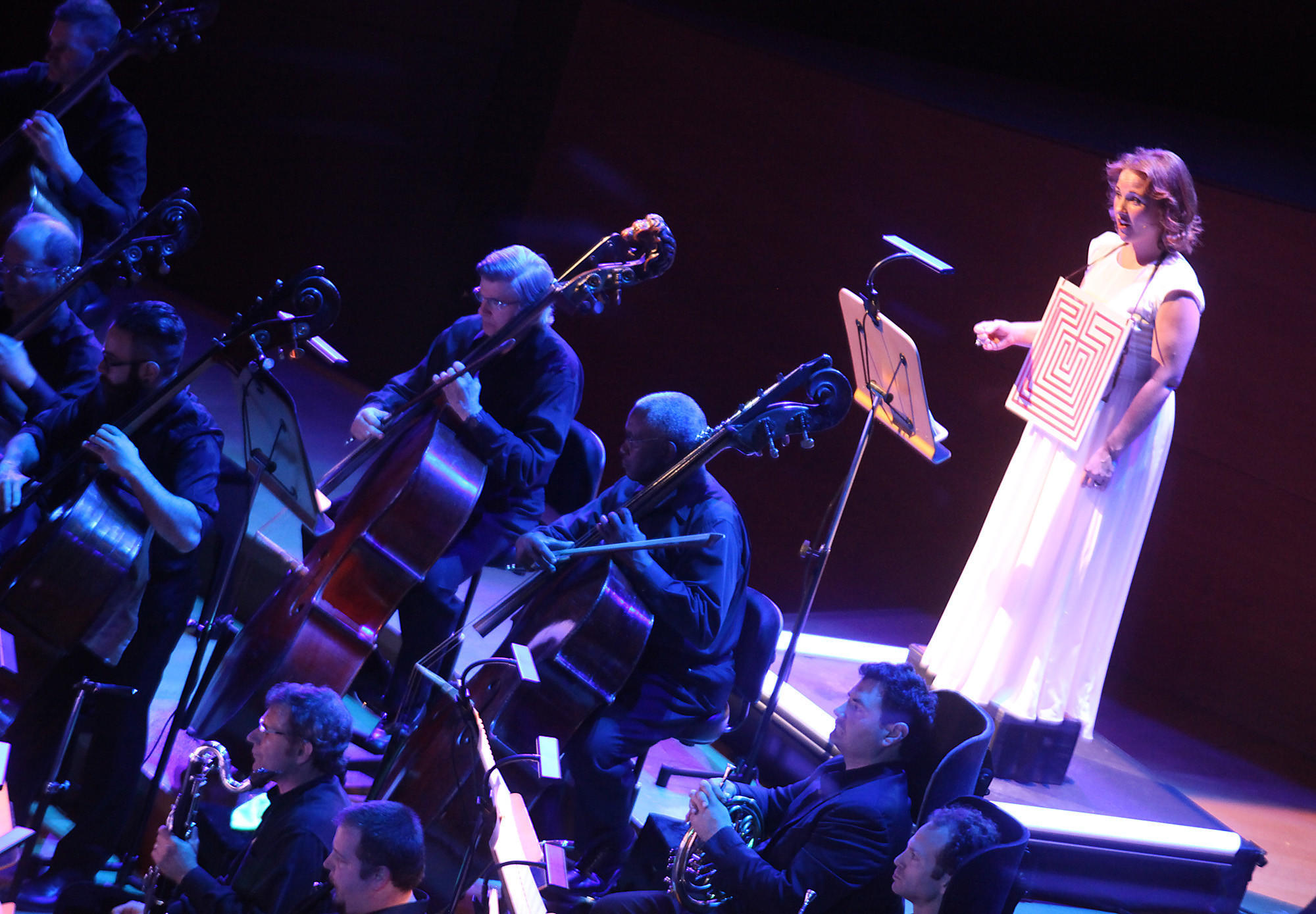 """Soloist Sasha Cooke, right, onstage with the L.A. Philharmonic in performance of Philip Glass' score to Rome section of Robert Wilson's """"The CIVIL warS."""""""