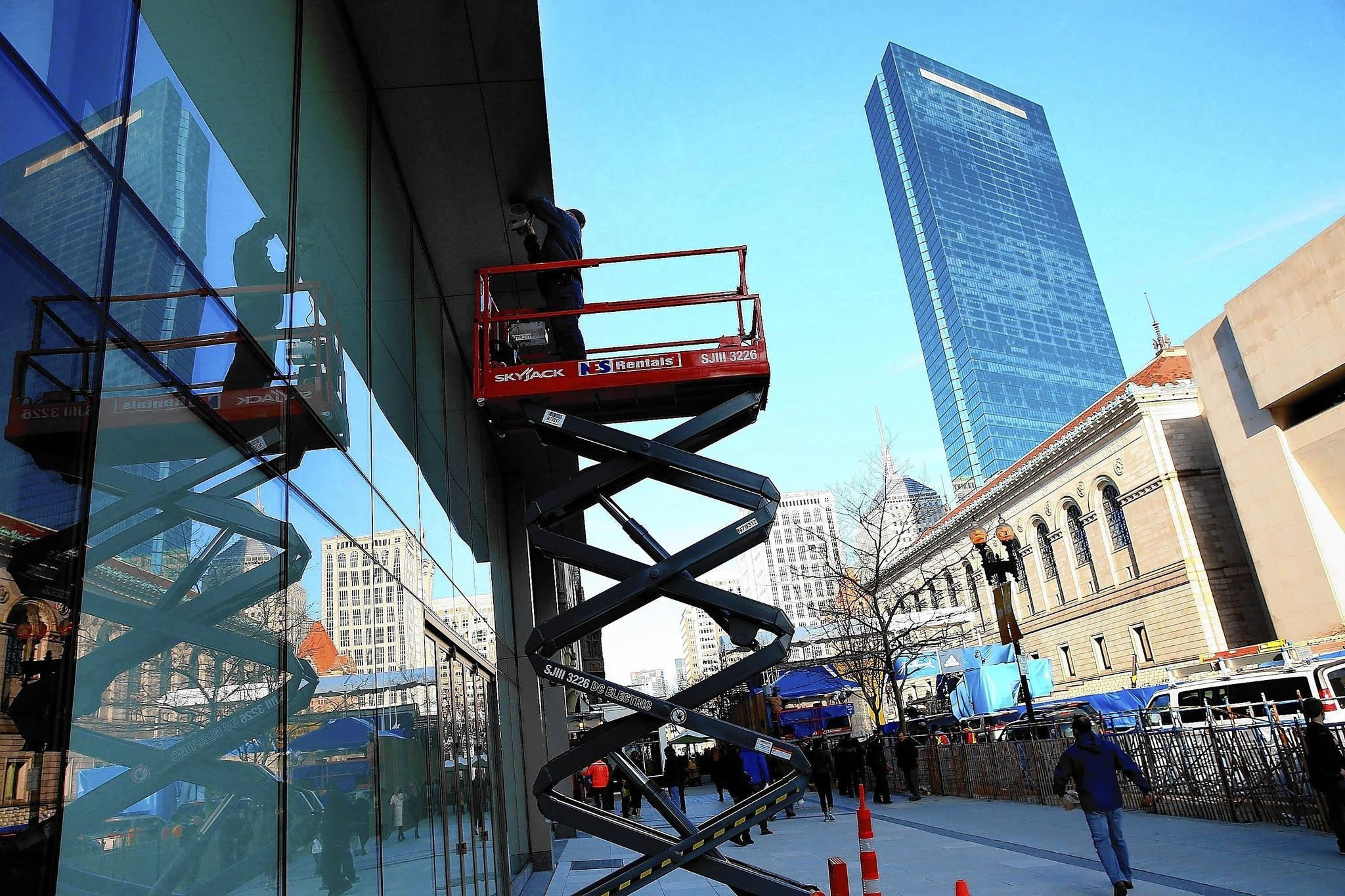 A security camera, one of 100 along the route of the Boston Marathon, is installed on Boylston Street near the finish line. The race will be held Monday.