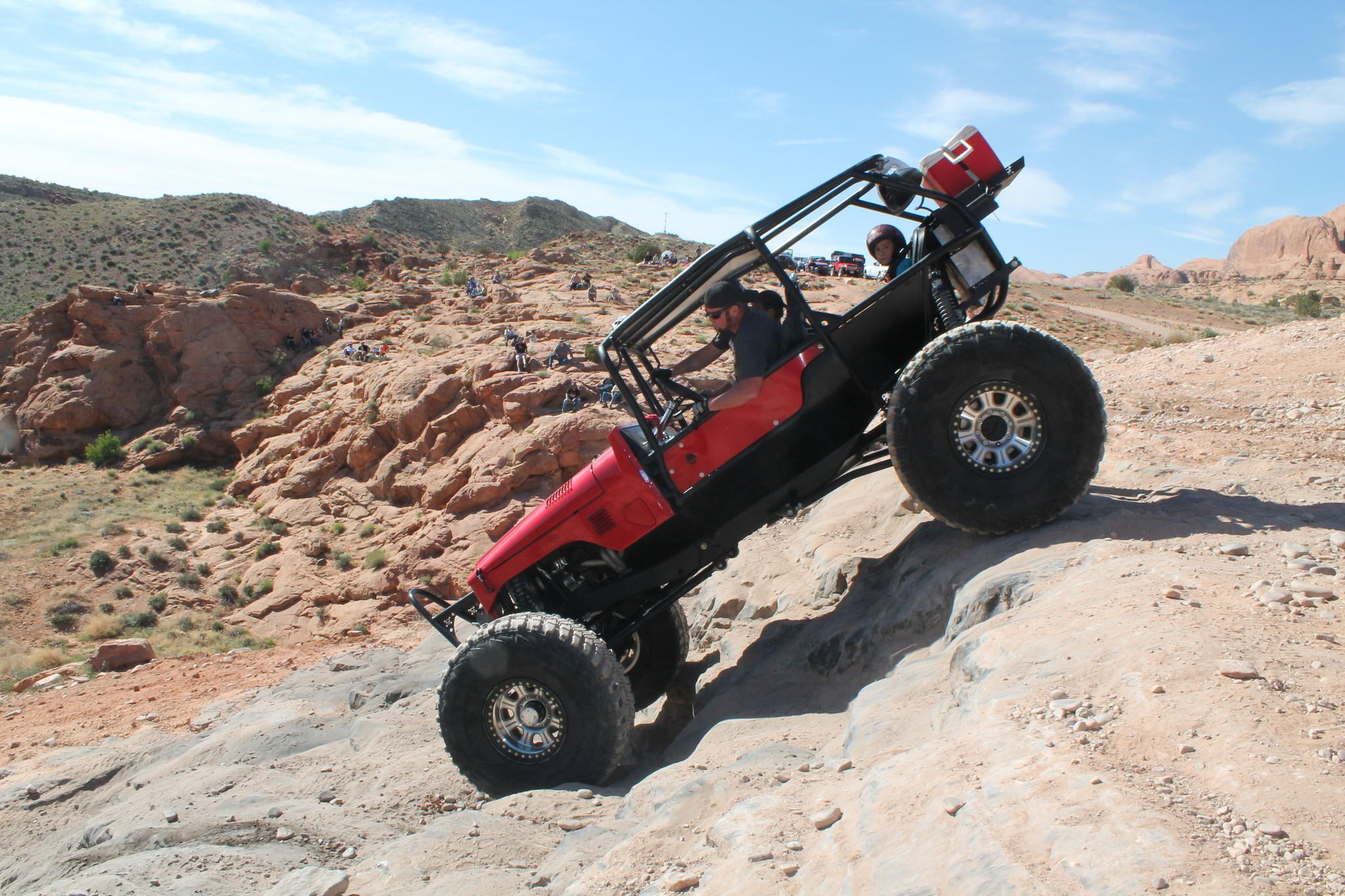 An off-roader and his family descend Potato Salad Hill outside Moab, Utah.