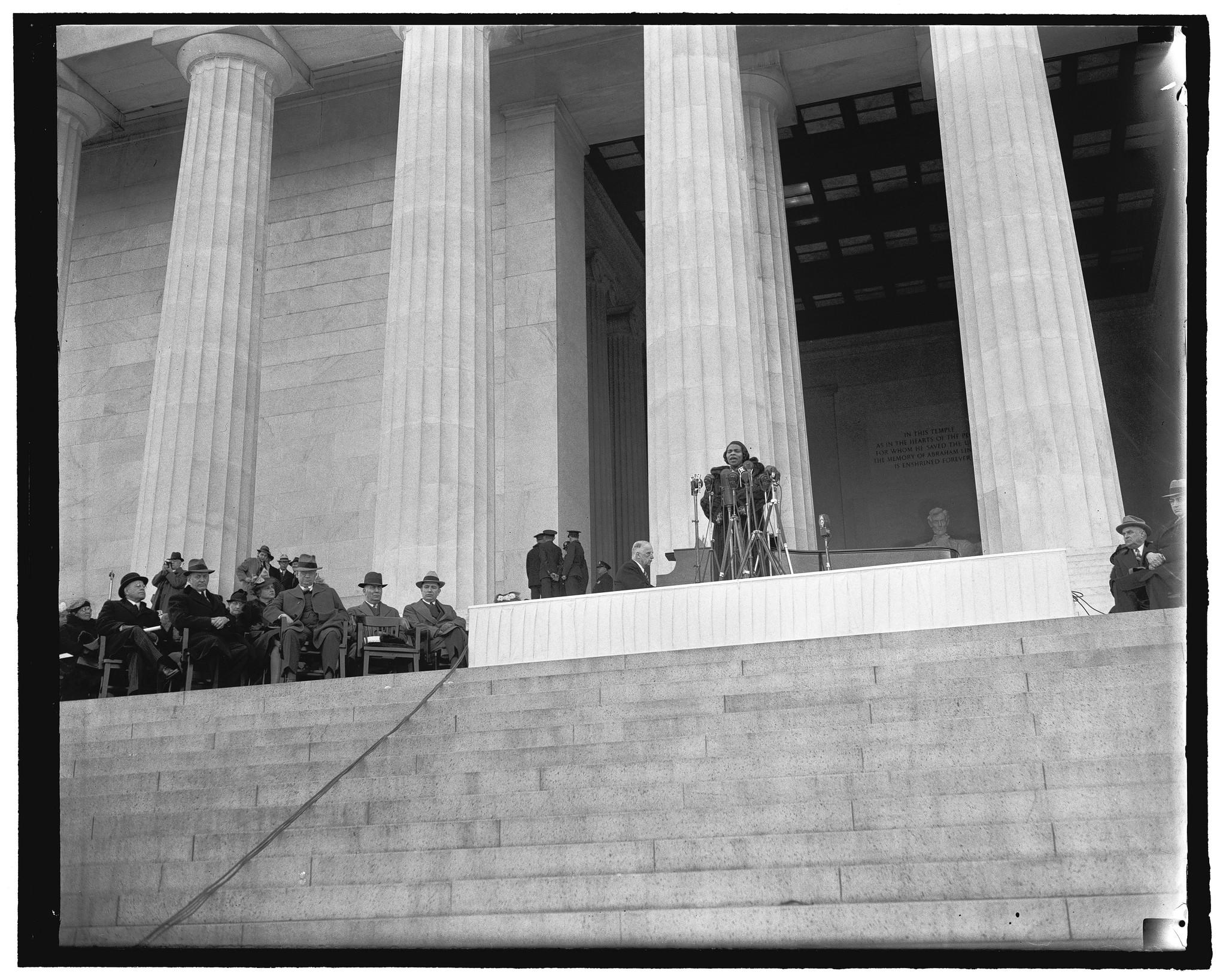 Marian Anderson sings at the Lincoln Memorial on Easter Day in 1939 to an audience of 75,000 on the Mall. Cabinet members and senators are seated onstage.