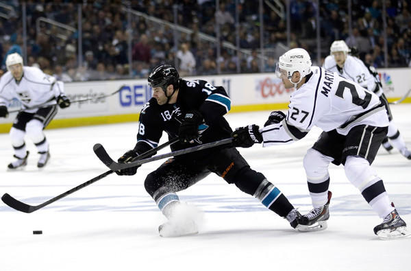 "Kings defenseman Alec Martinez, battling Sharks winger Mike Brown for the puck Thursday night, says of the 6-3 loss in Game 1: ""We'll learn from it, and that's why there's seven games."""