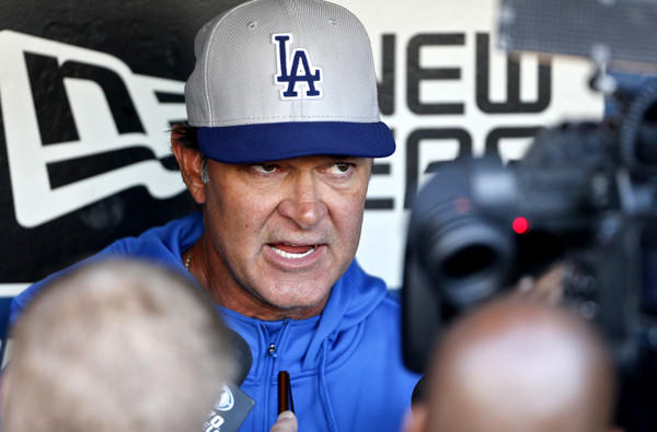 Dodgers Manager Don Mattingly holds a pregame chat with reporters before a game earlier this season in San Diego.
