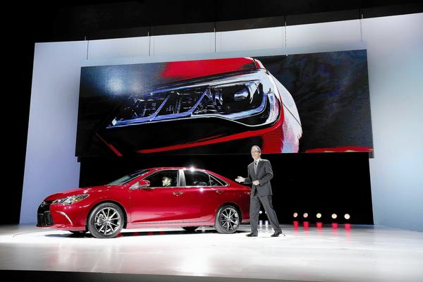 Although Toyota sold more than 400,000 Camrys last year — about 16% of the mid-size sedan market — consumers have requested improvements, says Bill Fay, general manager of Toyota's U.S. sales division. Above, Fay introduces the redesigned 2015 Camry at the New York International Auto Show this week.
