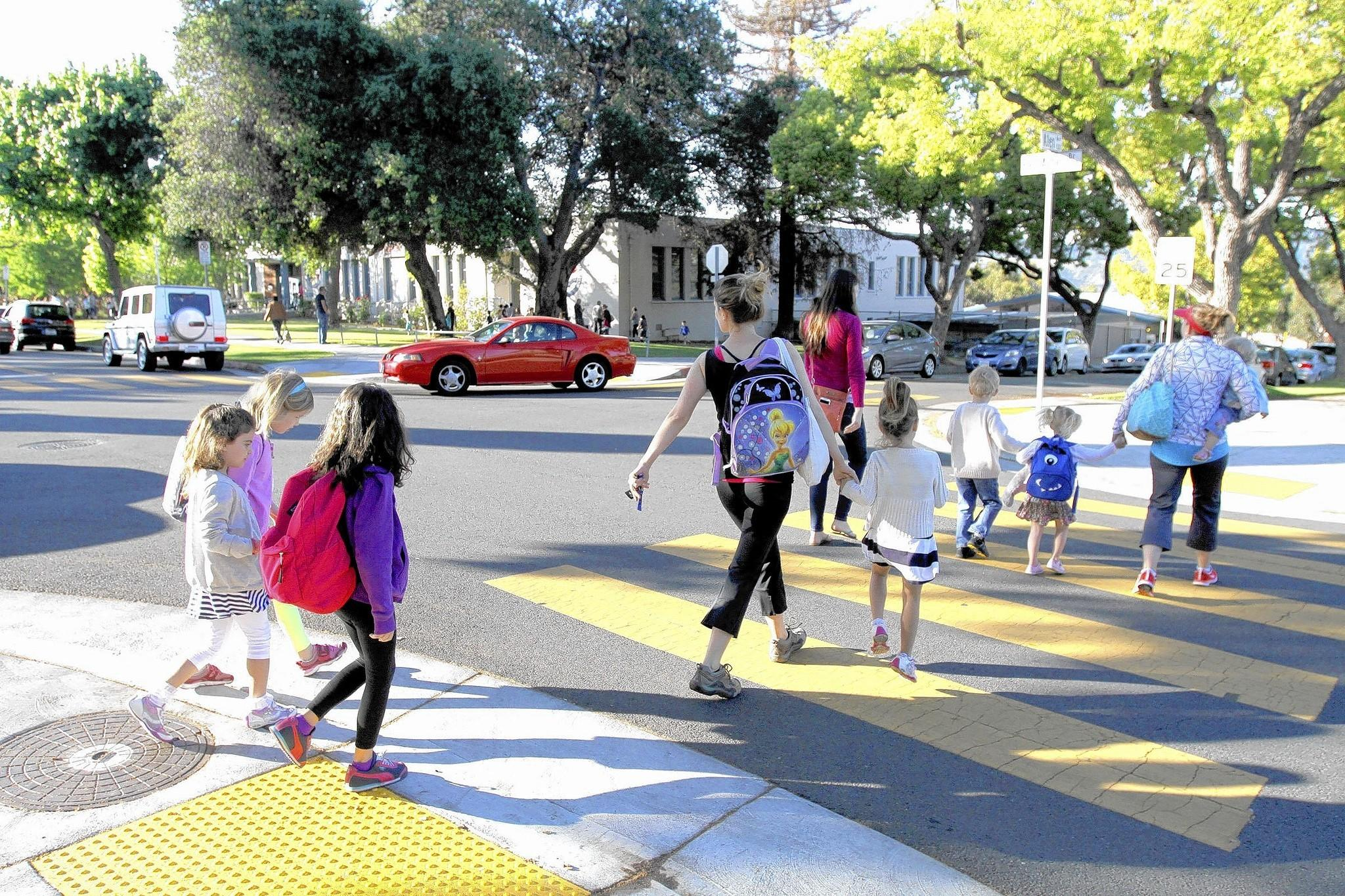 A group of parents and children cross at Allen Avenue and Bel Aire Drive in front of Balboa Elementary School in Glendale on Thursday, April 10, 2014. There are no crossing guards at this location.