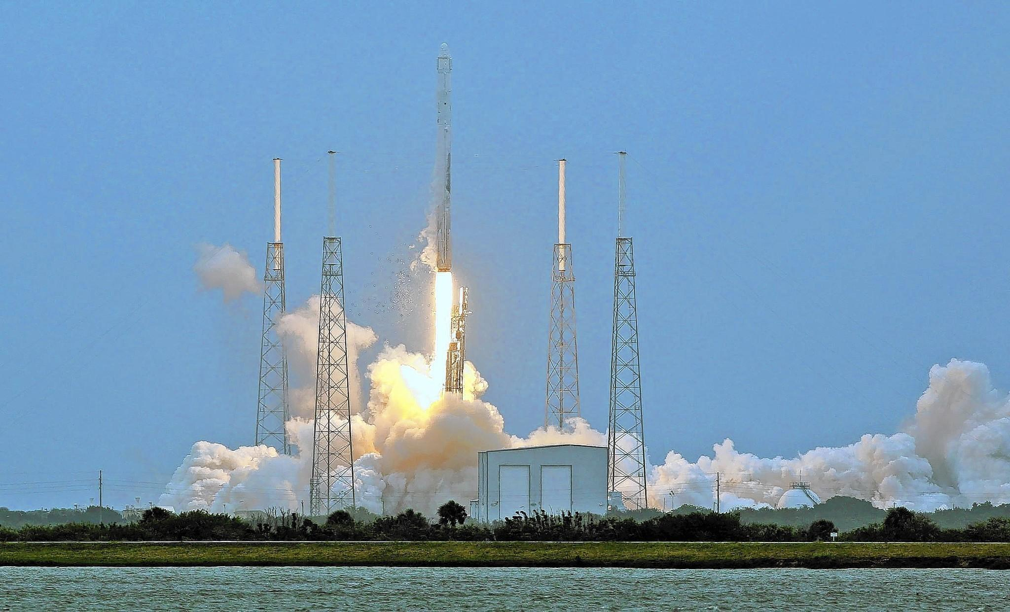 A SpaceX Falcon 9 rocket launches from Cape Canaveral Air Force Station carrying a capsule with 5,000 pounds of supplies. The Dragon capsule is scheduled to rendezvous with the space station Sunday.
