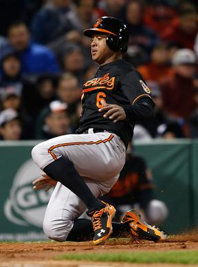 Jonathan Schoop scores a run against the Red Sox in the third inning at Fenway Park.