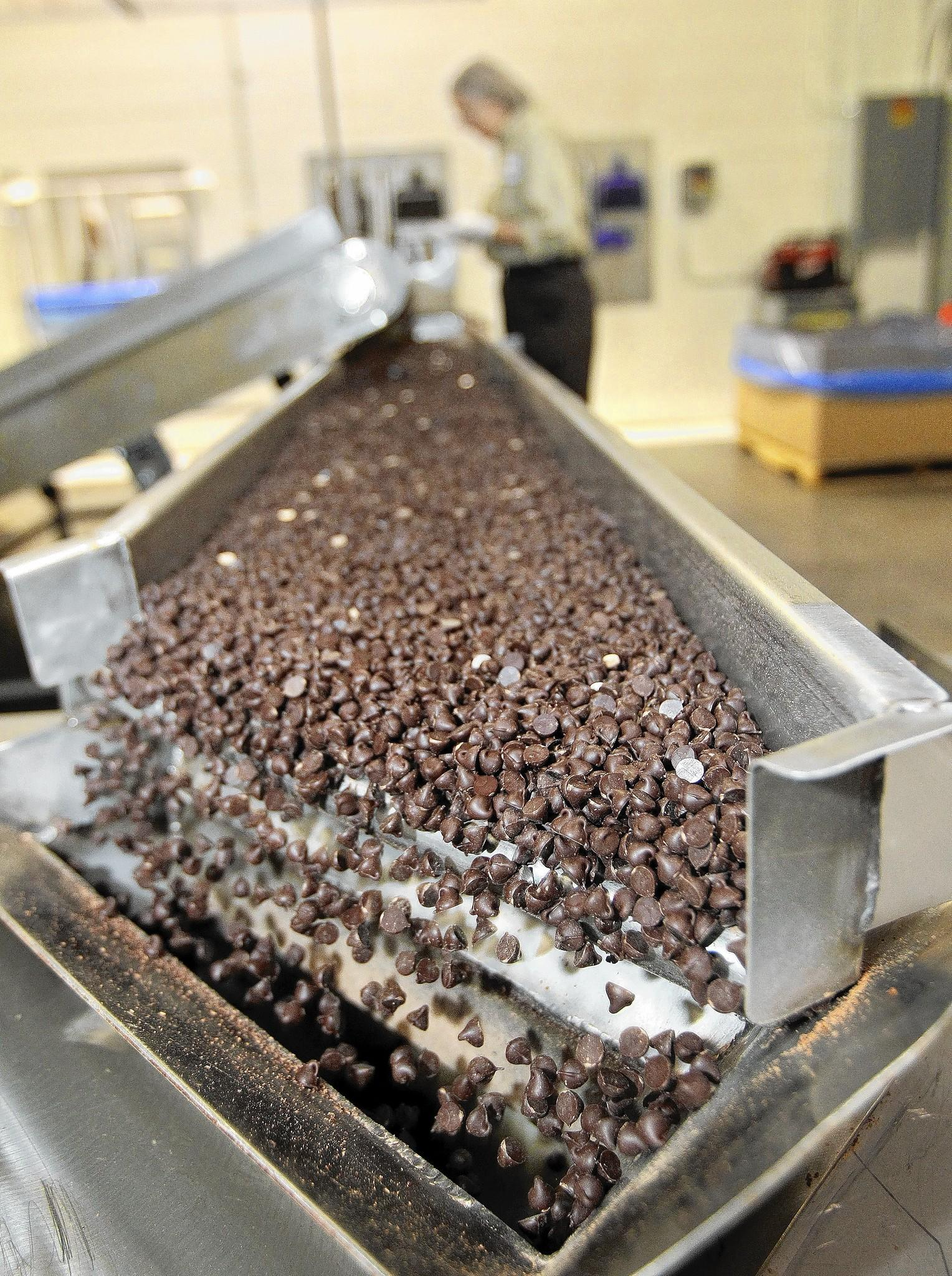 Chocolate chips fall off a conveyor belt and into a hopper at a Blommer Chocolate Co. plant in East Greenville, Pa. Chicago-based Blommer is North America's oldest and largest cocoa bean processor.