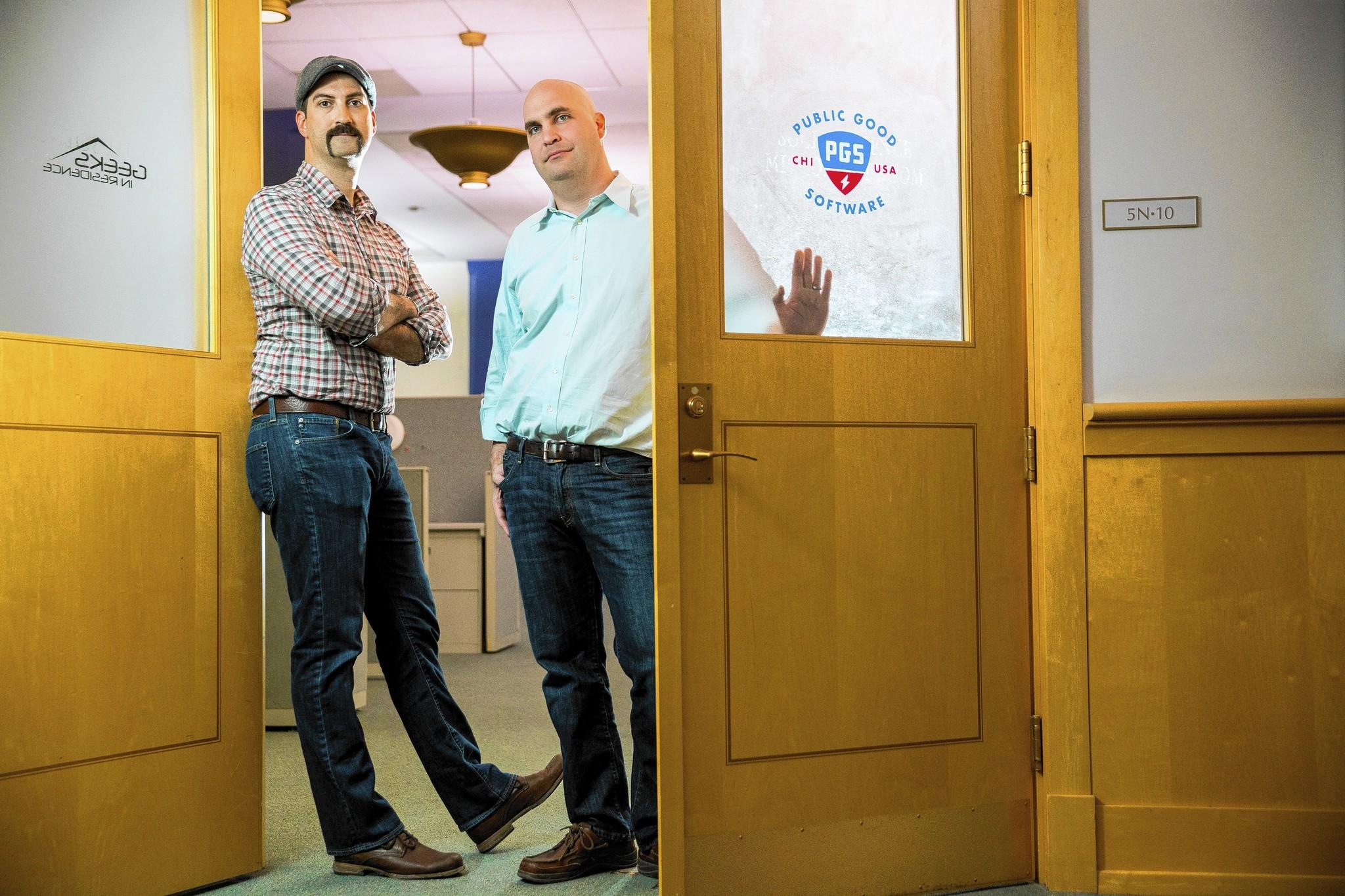 Jason Kunesh, left, and Dan Ratner are the co-founders of Public Good Software. They have offices in Chicago's Harold Washington Library.