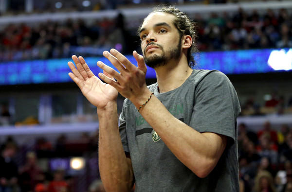 Bulls center Joakim Noah applauds his teammates' effort during a 102-90 victory over the Milwaukee Bucks earlier this month in Chicago.
