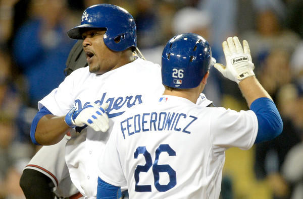 Dodgers third baseman celebrates with catcher Tim Federowicz after hitting a home run in the bottom of the ninth inning against the Diamondbacks to send the game into extra innings.
