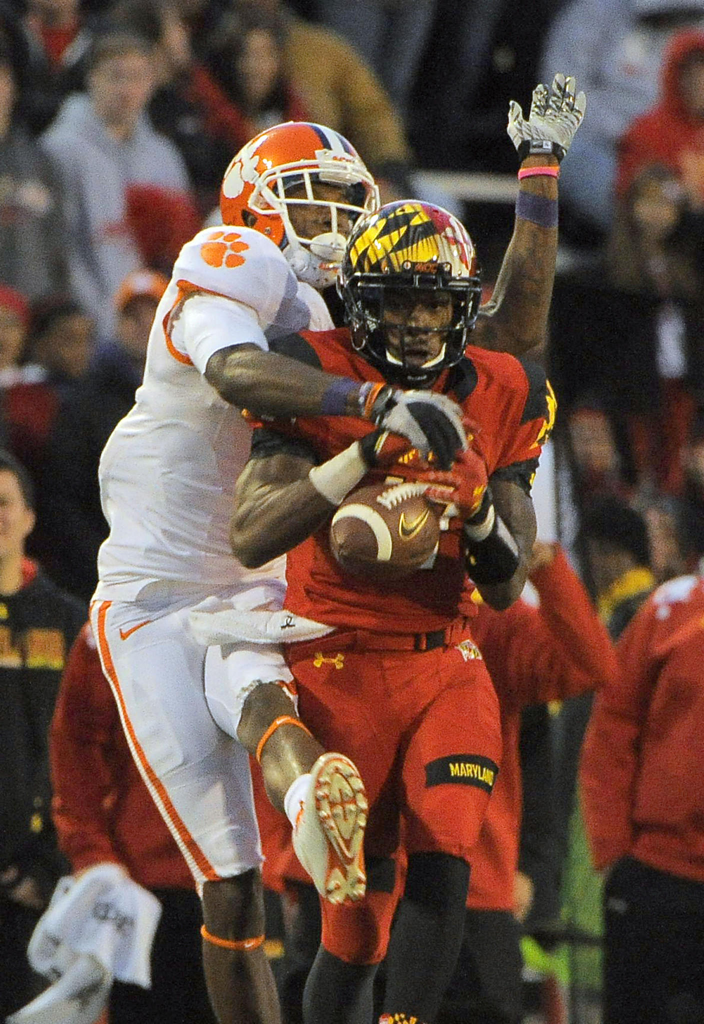 Maryland Terrapins defensive back Isaac Goins is in position to make a crucial interception but fails to maintain possession of the ball as Clemson Tigers wide receiver Martavis Bryant slaps it down during the fourth quarter at Byrd Stadium Saturday, Oct. 26, 2013.