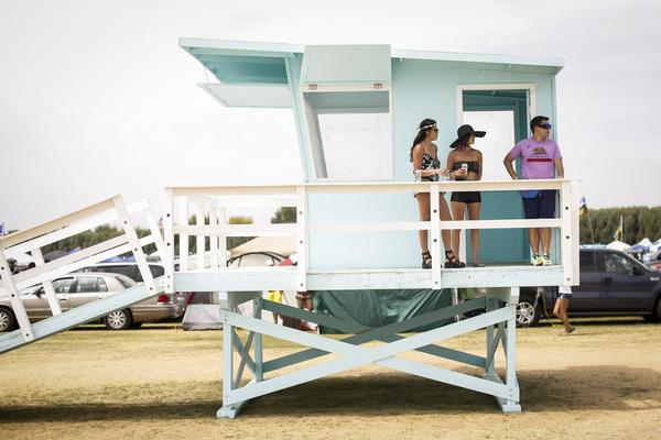 "People take in the view of the car camping area from one of the art installations along ""Main Street,"" on the first day of the second weekend of the Coachella Valley Music and Arts Festival at the Empire Polo Club in Indio, Calif., on Friday, April 18, 2014."