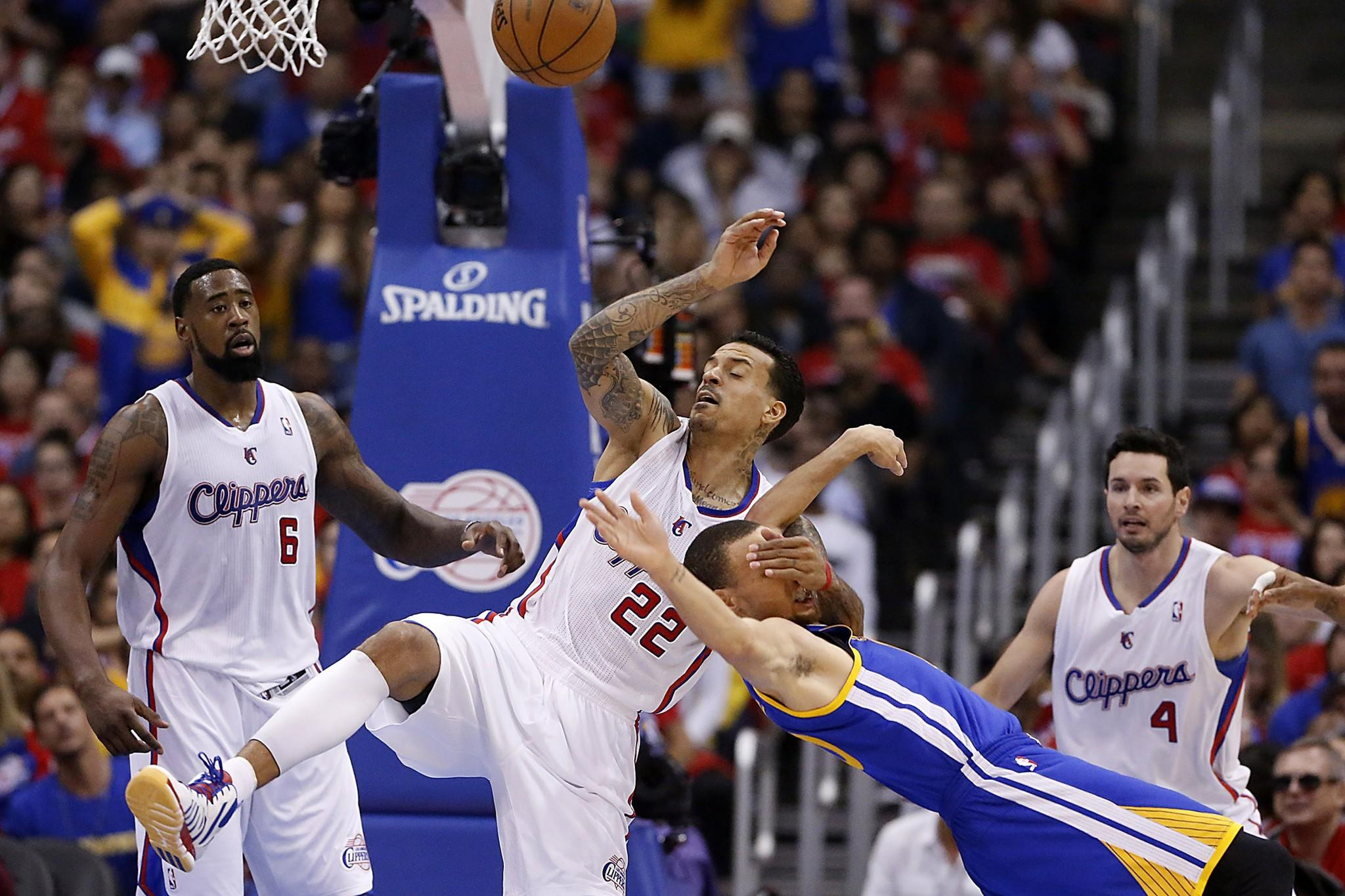 Clippers forward Matt Barnes gets tangled with Warriors point guard Stephen Curry after fouling him.