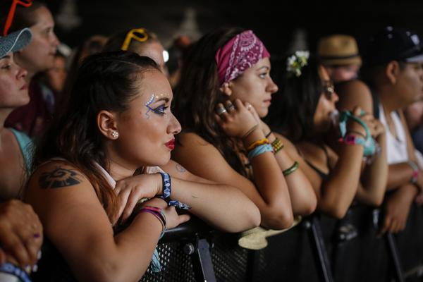Music fans, some with elaborately painted faces, wait for Kate Nash to begin on the first day of the second weekend of the Coachella Valley Music and Arts Festival.