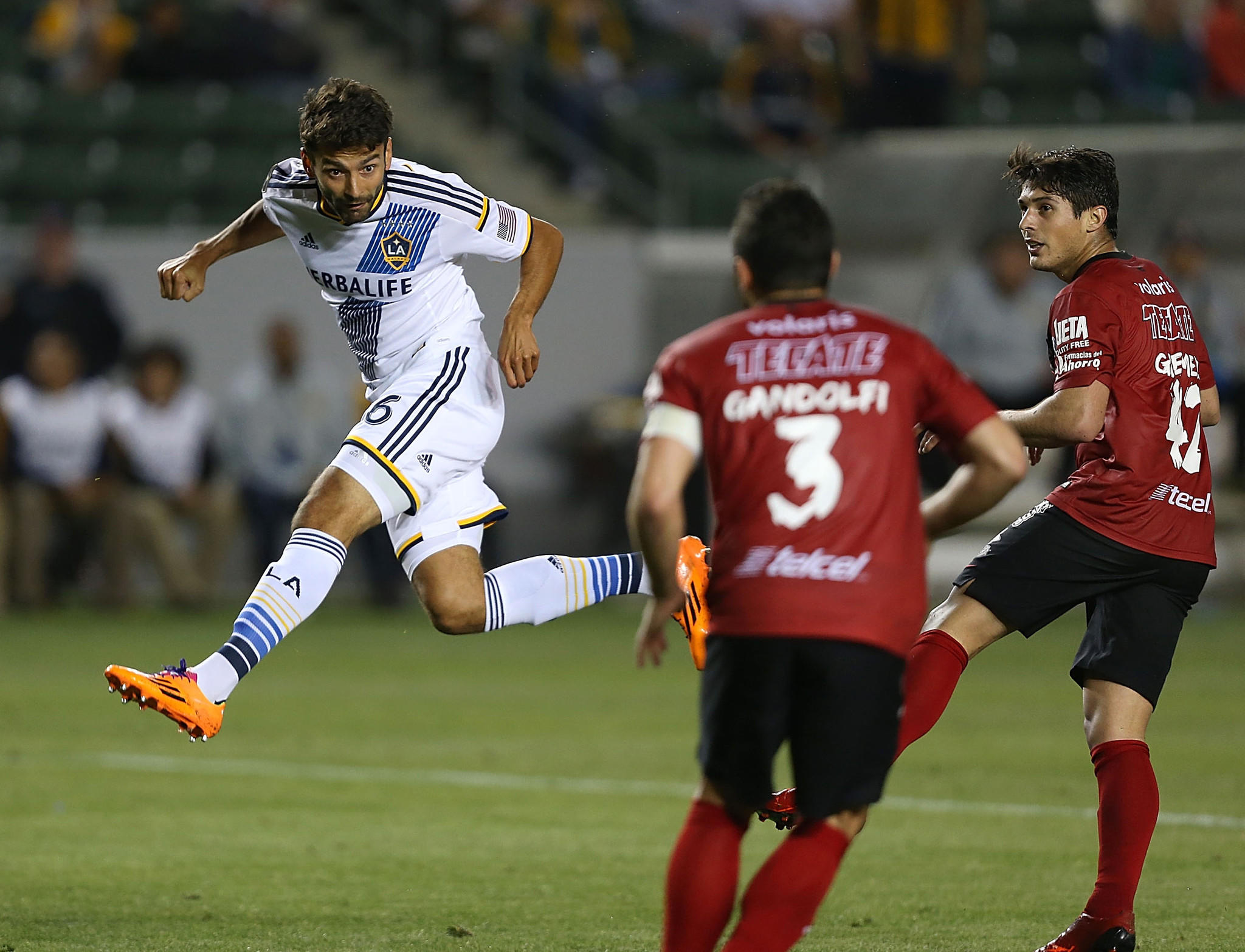 Galaxy midfielder Baggio Husidic, shown attempting a header against Club Tijuana on March 12, has scored once in four starts this season and solidified a diamond midfield that has been reconfigured to get the ball to striker Robbie Keane.