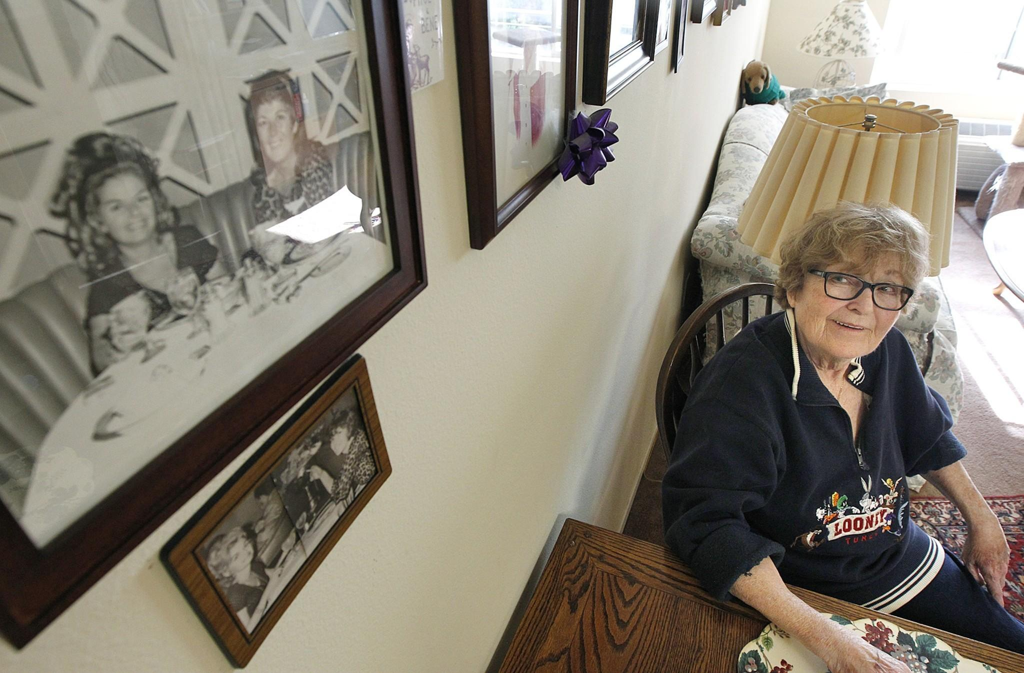 Alice Herman, 78, sits at the dining table of her Hollywood apartment at Triangle Square, the only senior living complex that caters to LGBT people in Los Angeles. Herman couldn't access her late partner's benefits and was planning to move into her car before getting an apartment at Triangle Square.