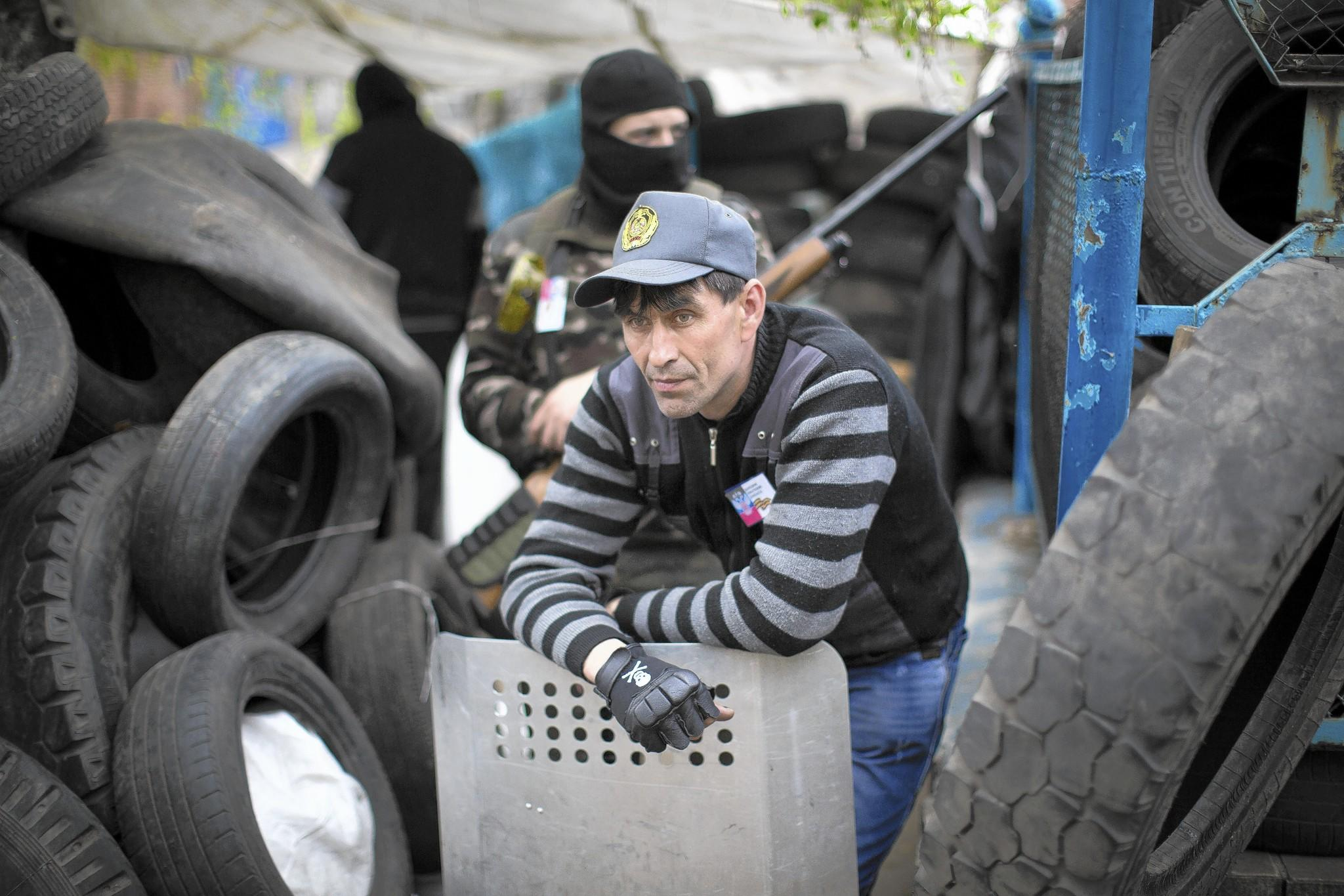 Pro-Russia activists guard barricades in Slovyansk, Ukraine.
