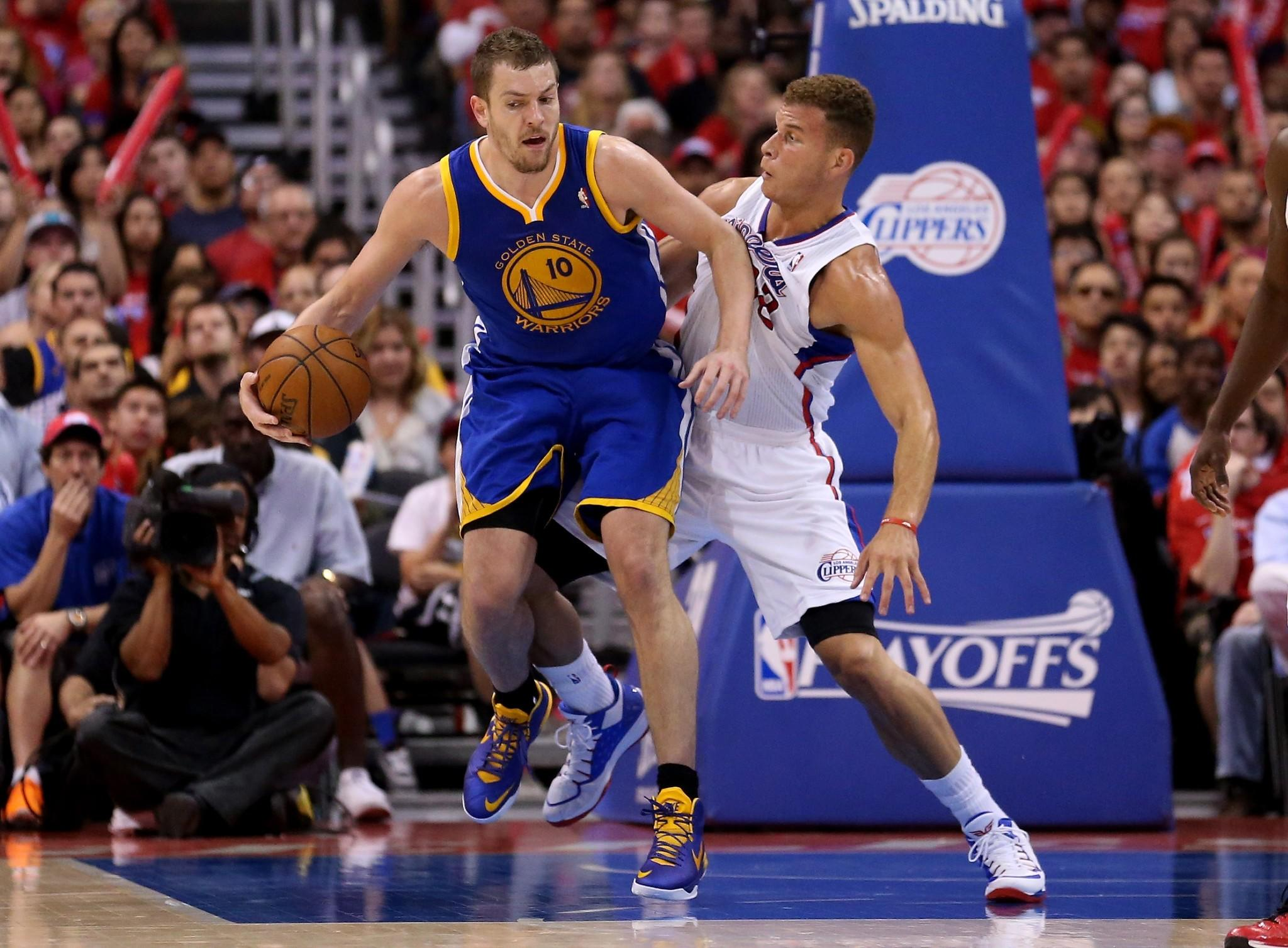 Golden State Warriors center David Lee, left, controls the ball in front of Clippers power forward Blake Griffin during the Clippers' 109-105 loss in Game 1 of the NBA Western Conference quarterfinals Saturday at Staples Center.