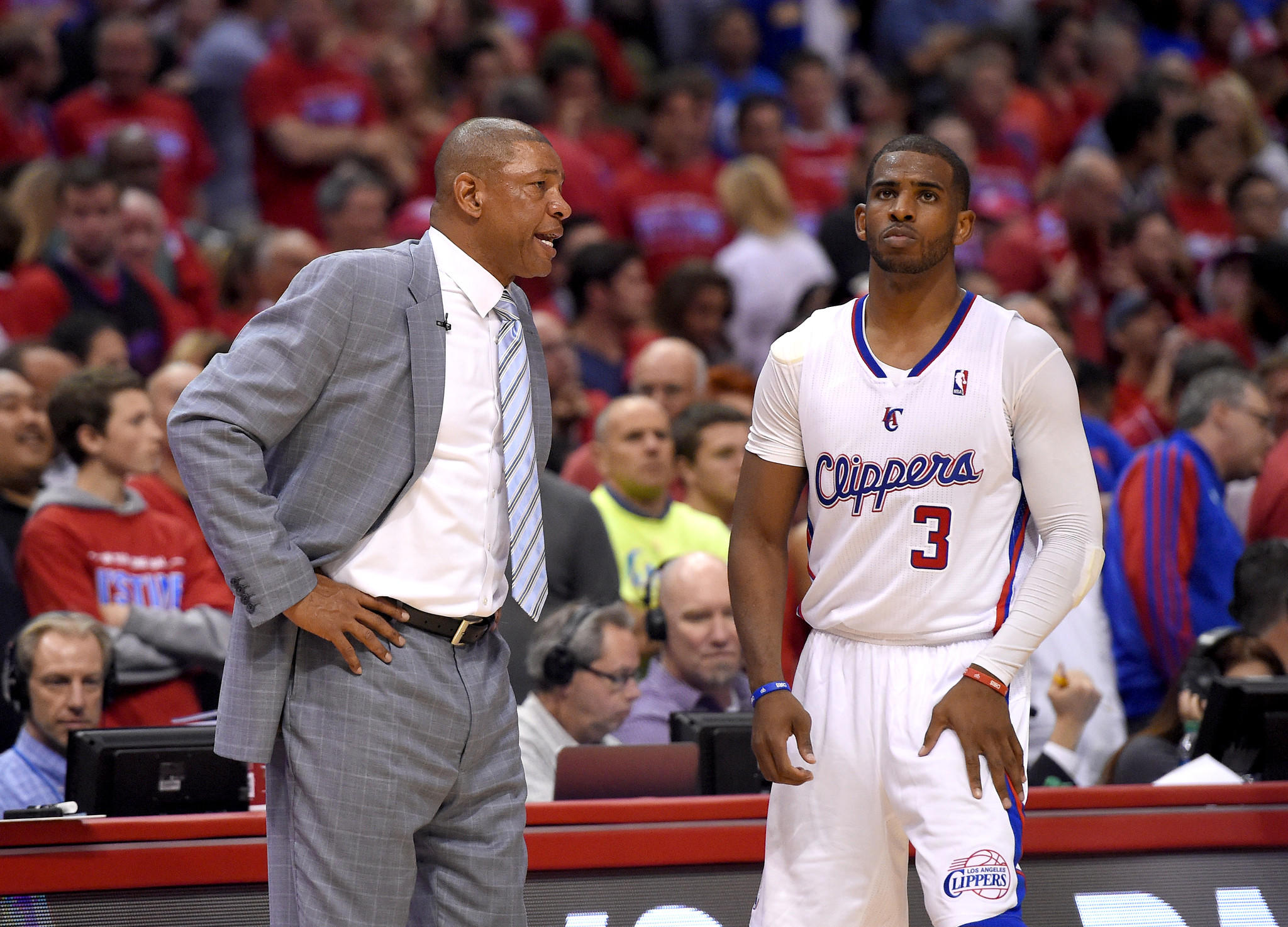 Clippers Coach Doc Rivers talks to point guard Chris Paul during the second half of Game 1 in their playoff series against the Golden State Warriors.