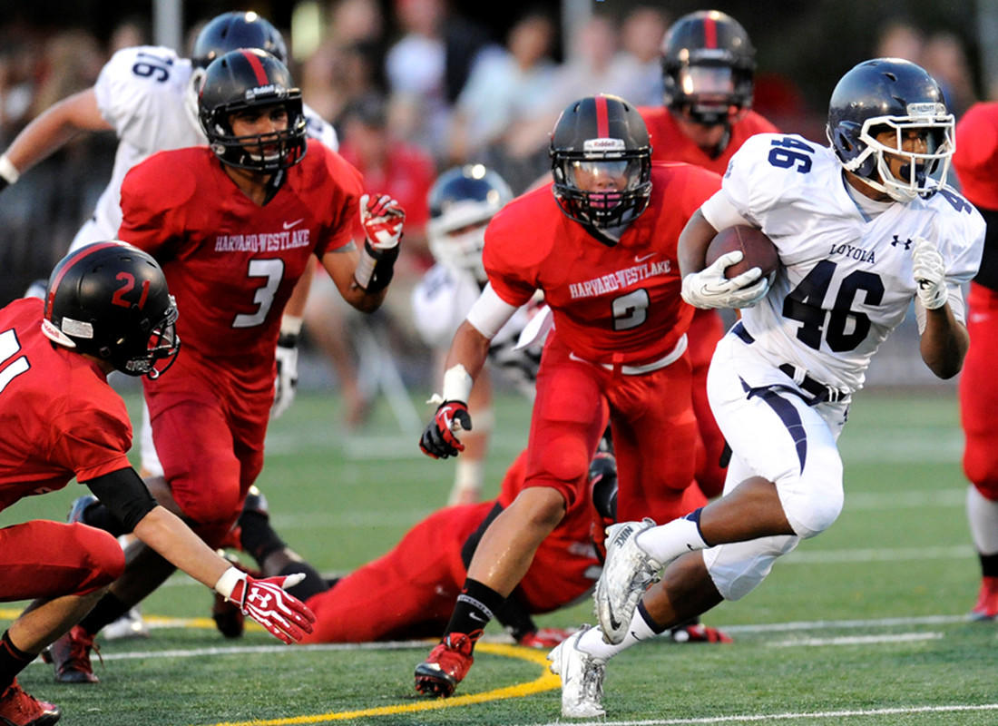 Loyola running back David Cooper breaks through the Harvard-Westlake line during a game last season.
