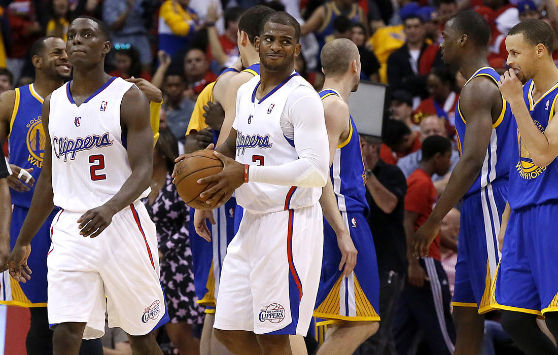 Clippers point guard Chris Paul casts a look toward the referees in the final seconds of a 109-105 loss to the Golden State Warriors on Saturday at Staples Center.