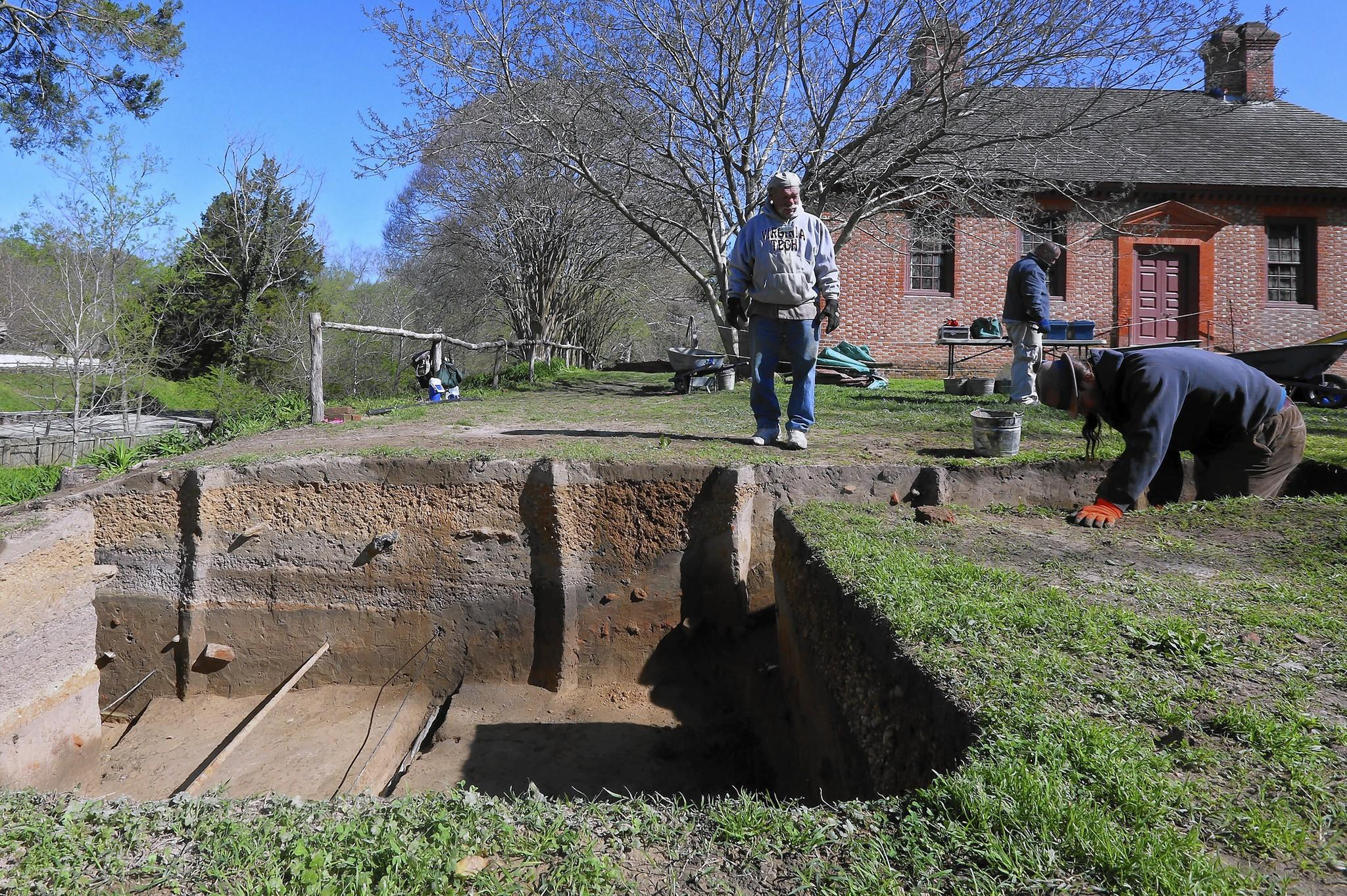 Colonial Williamsburg archaeologists exploring a ravine just off Duke of Gloucester Street have unearthed deep layers of fill dating as far back as 1747 that were used to reshape the town's landscape.