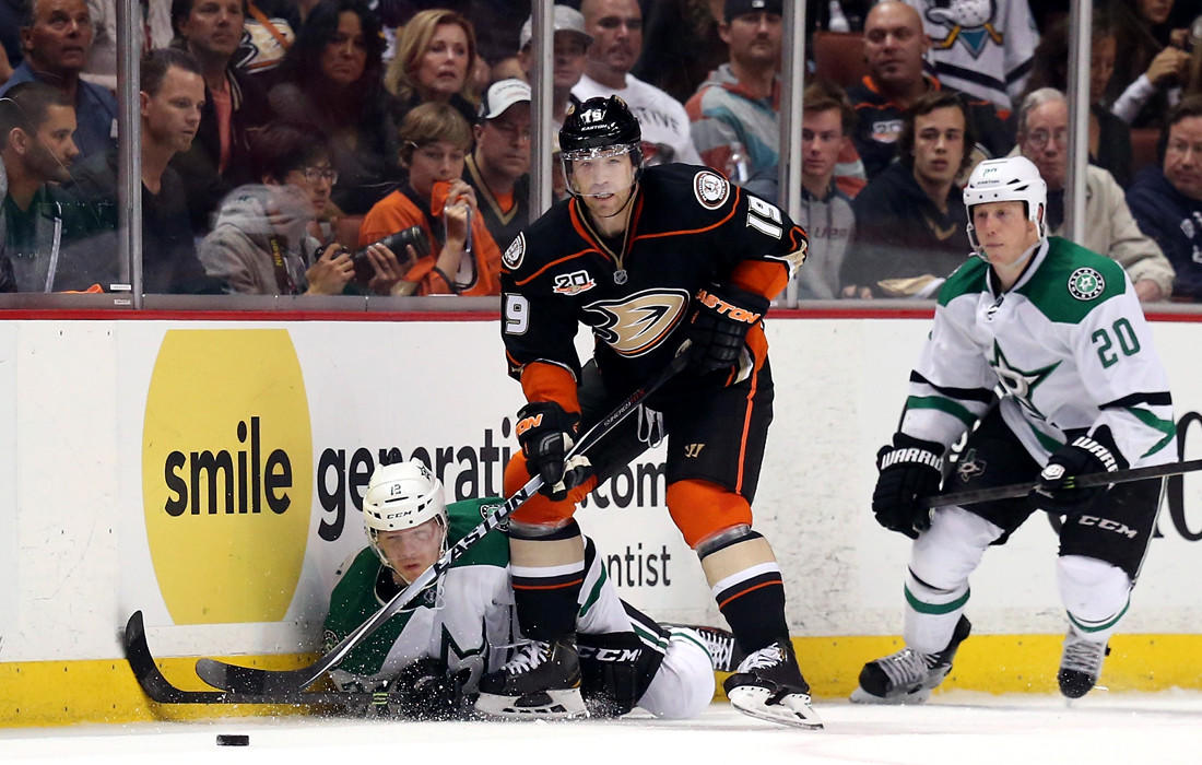 Ducks defenseman Stephane Robidas (19) clears the puck after battling the Stars' Alex Chiasson and Cody Eakin (20) in the third period of Game 2 on Friday night at Honda Center.