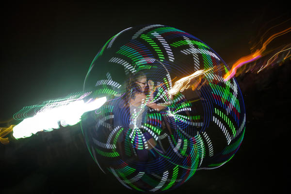 Cameron Doss, 24, performs hoop dancing during the OutKast performance to close the Main Stage, on the first day of the second weekend of the Coachella Valley Music and Arts Festival.