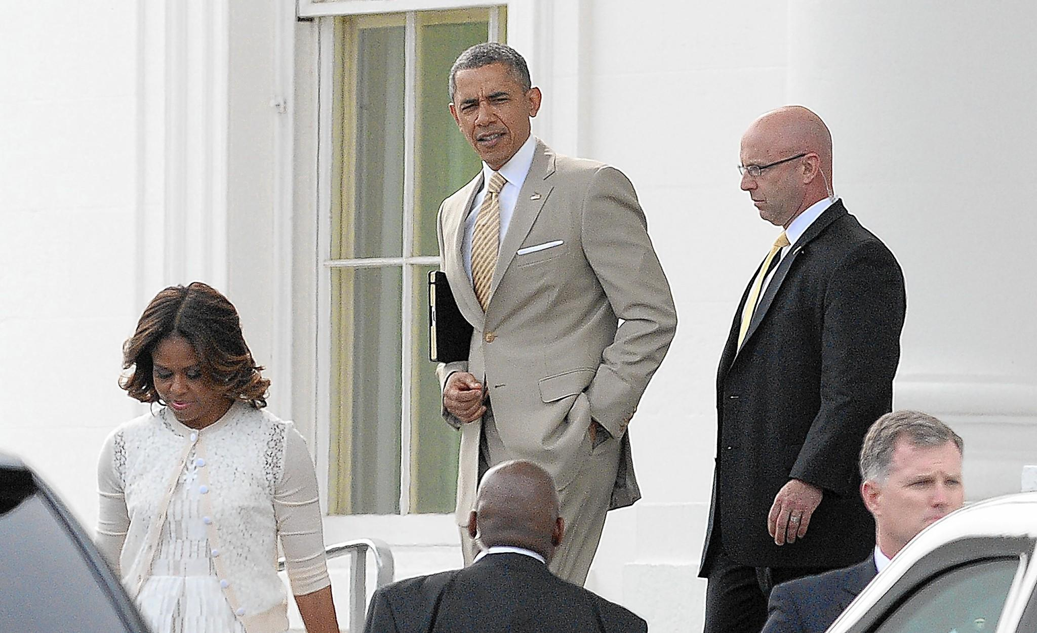 President Obama leaves the White House with Michelle to attend an Easter service in Washington. The president is to set out on a tour of Asia later this week.