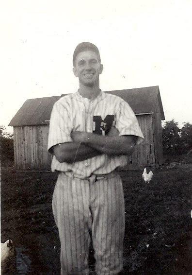 Louis Reinhart as a young baseball player.
