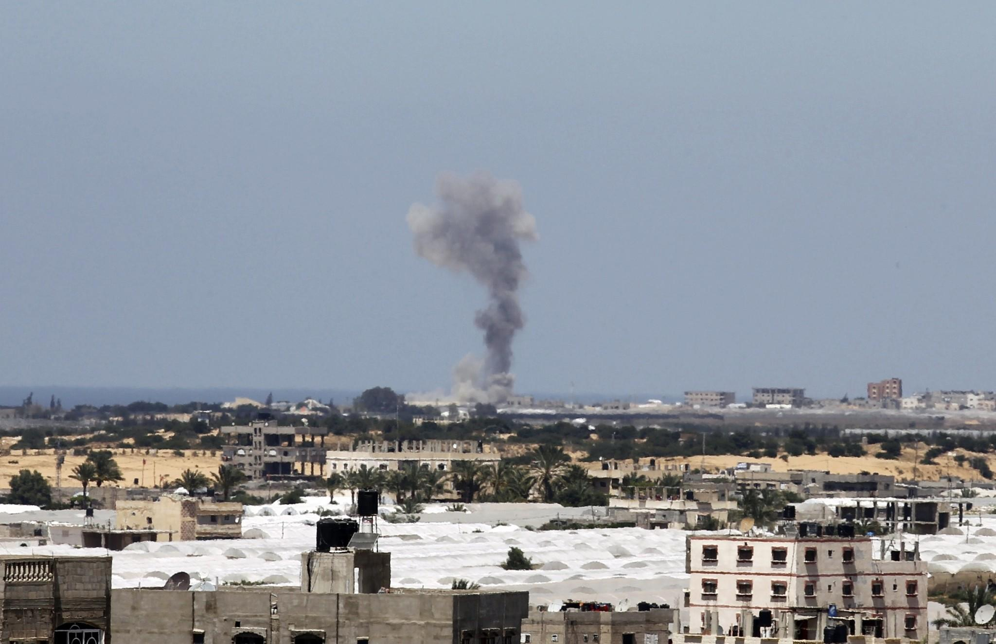 Smoke rises following an Israeli strike Monday on Rafah in the southern Gaza Strip, hours after Palestinian militants in the coastal enclave fired seven rockets into Israel, causing no casualties.