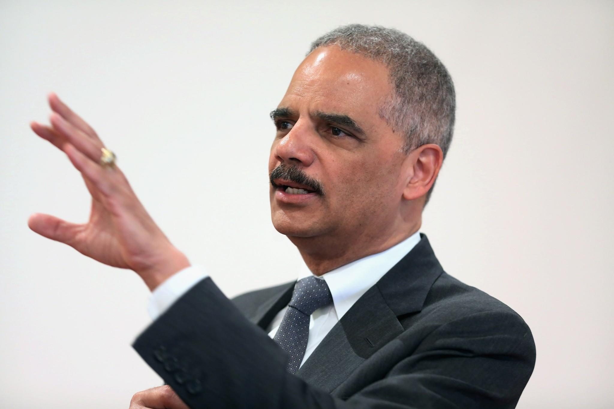 Atty. Gen. Eric Holder addresses the Police Executive Research Forum's National Summit on Illegal Drugs in Washington.