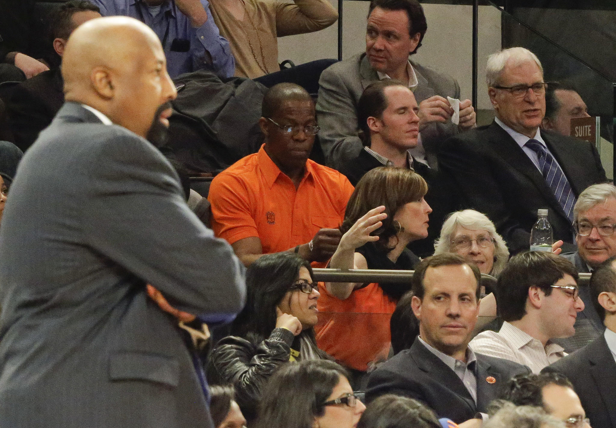 New York Knicks President Phil Jackson, far right, and then-coach Mike Woodson, far left, watch their team play the Wizards.