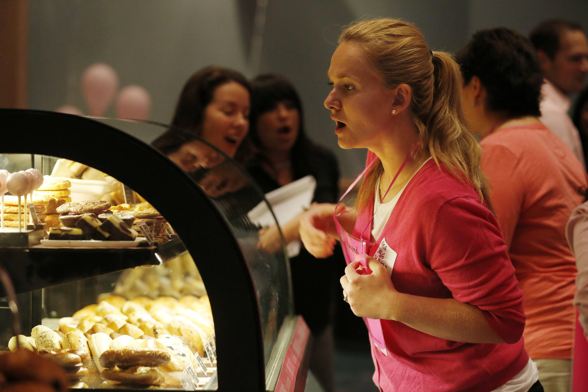 People look at the Starbucks pastry case in suburban Chicago.