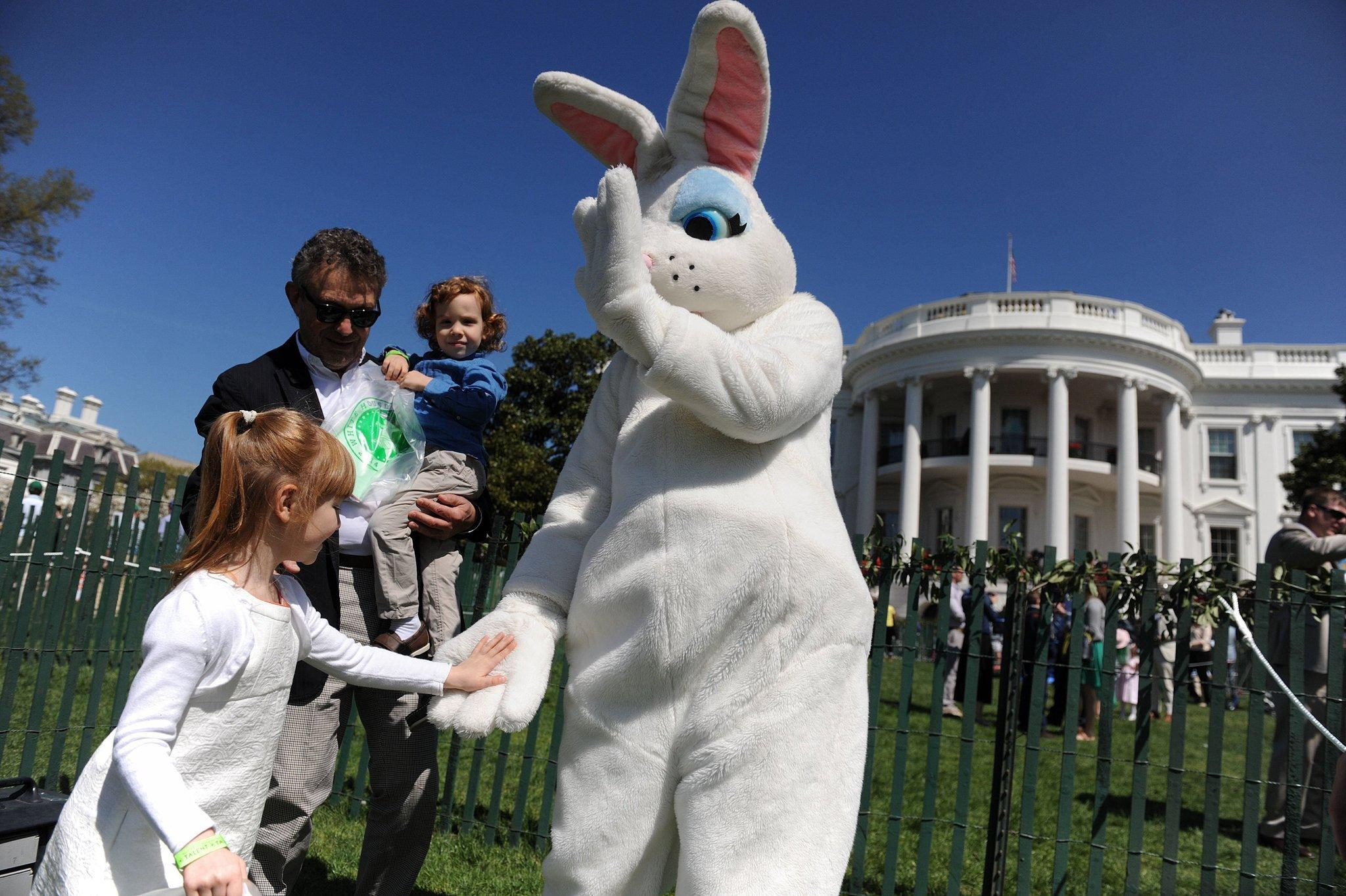 The Easter Bunny greets children during the annual White House Easter Egg Roll on the South Lawn of the White House.