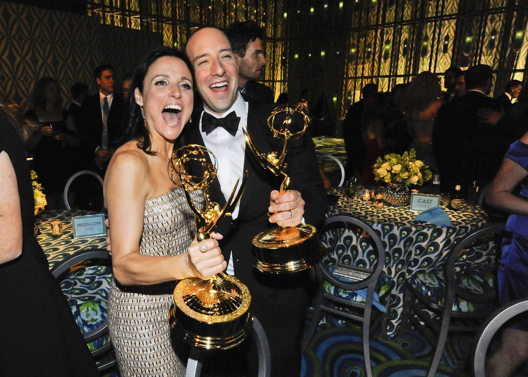 Actress Julia Louis-Dreyfus (L), winner of the Best Actress in a Comedy Series, and actor Tony Hale, winner of the Best Supporting Actor in a Comedy Series, celebrate at the 65th Primetime Emmy Awards HBO after party in West Hollywood September 22, 2013.