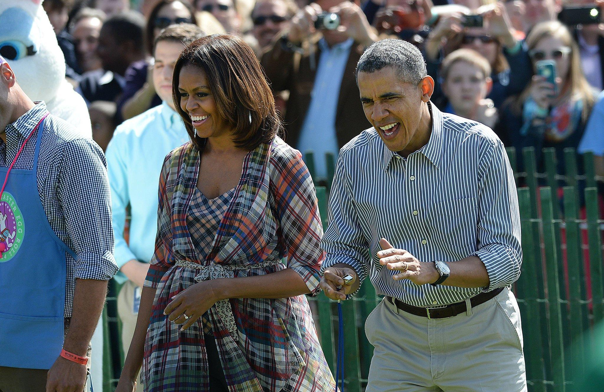 President Obama and First Lady Michelle Obama watch children participate in the annual White House Easter Egg Roll.