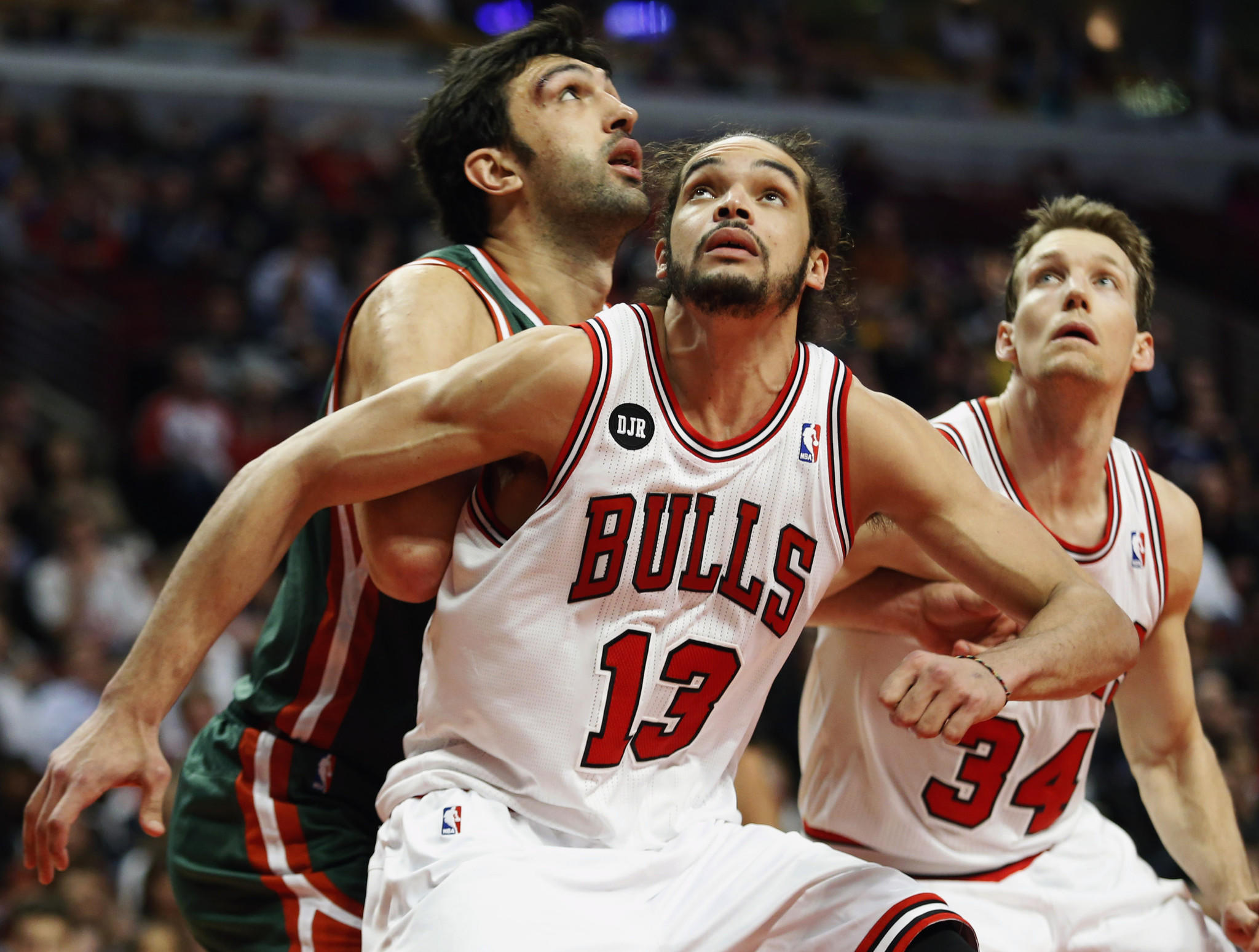 Chicago center Joakim Noah defends against Milwaukee center Zaza Pachulia.