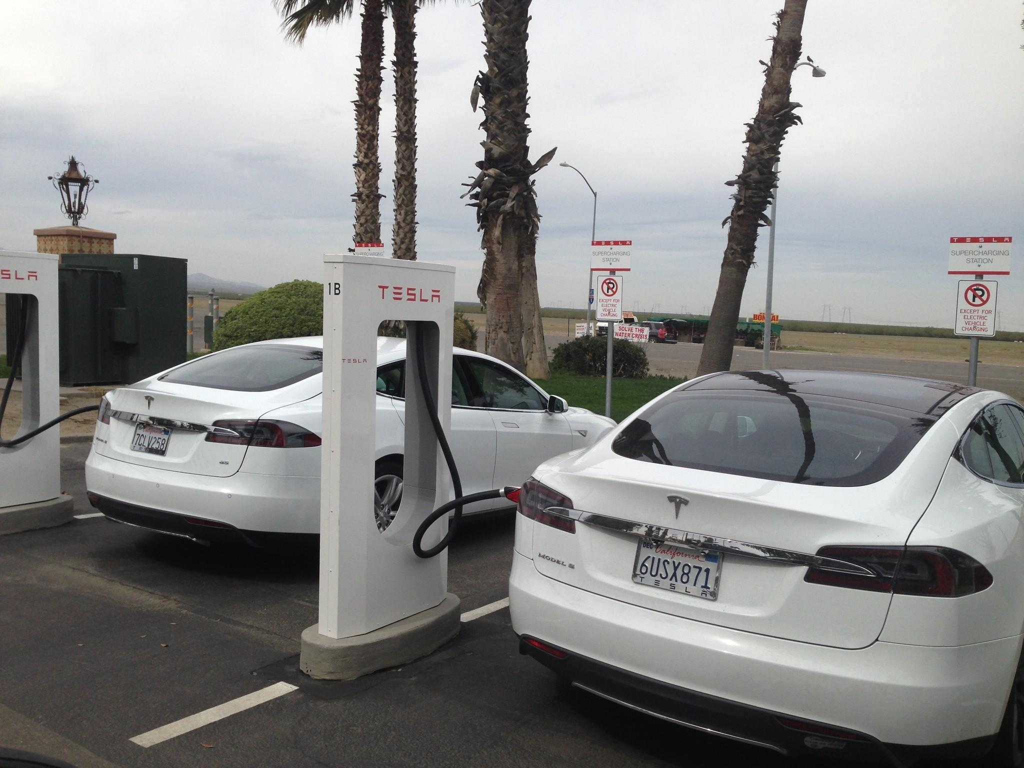 A pair of Teslas suck up some electricity at a charging station near Harris Ranch, Calif.